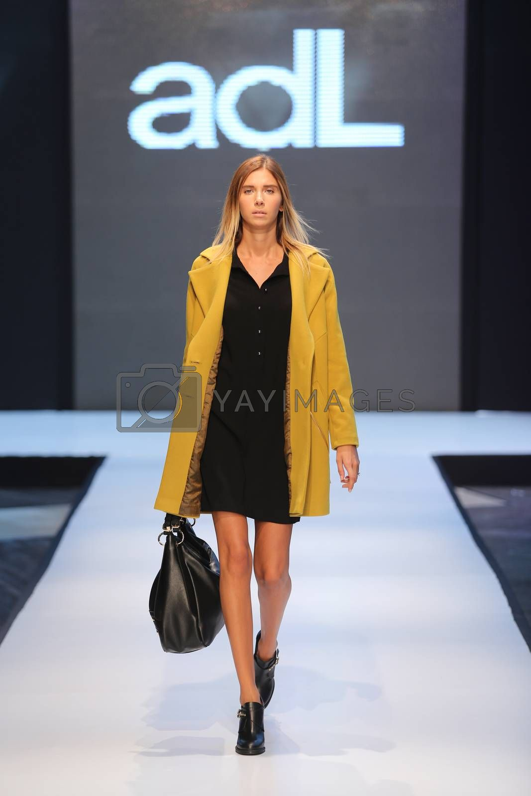 ISTANBUL, TURKEY - OCTOBER 10, 2015: A model showcases one of the latest creations of ADL in Forum Fashion Week