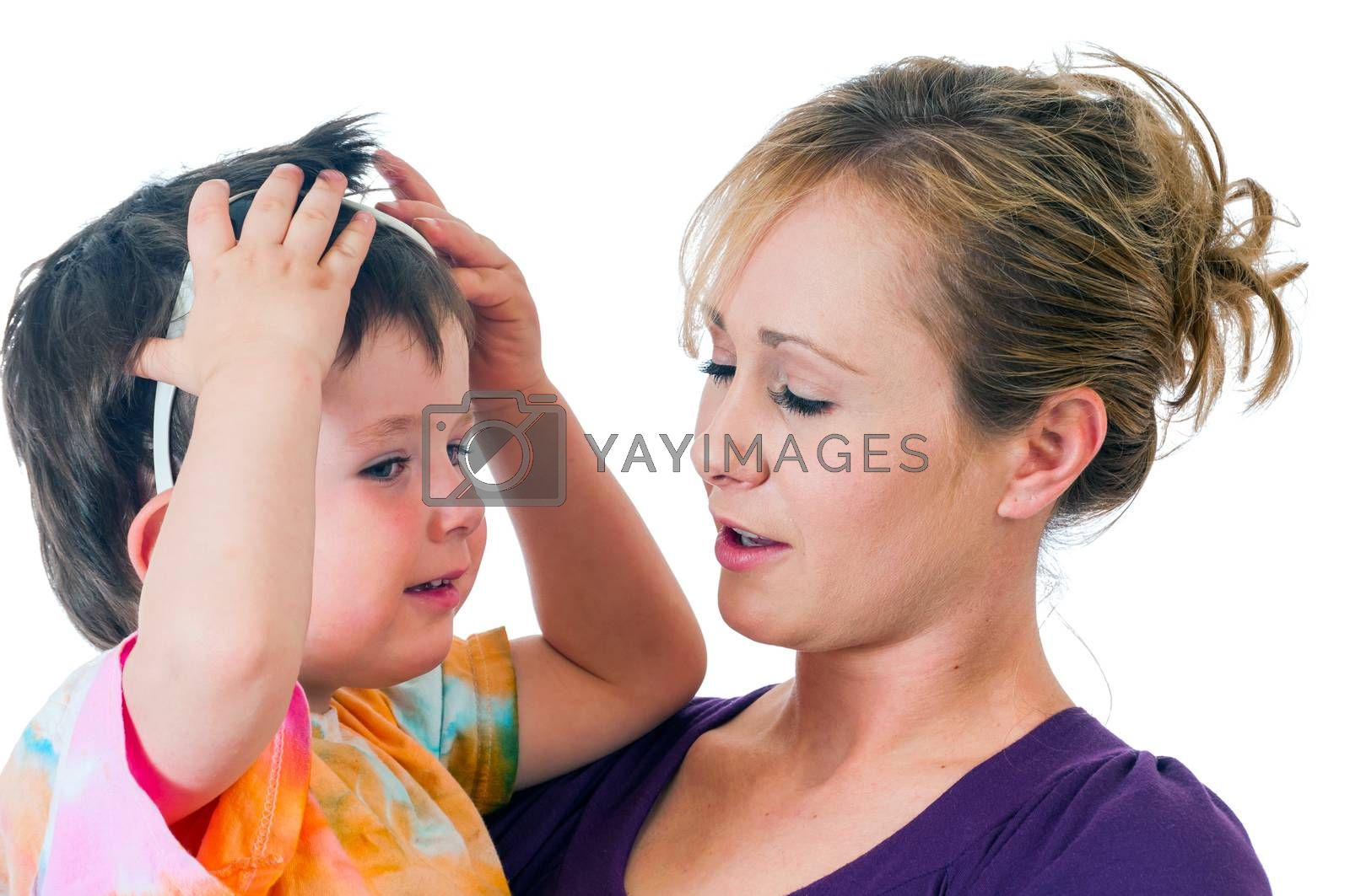 Pretty young woman holding a three year old boy playing with sunglasses.