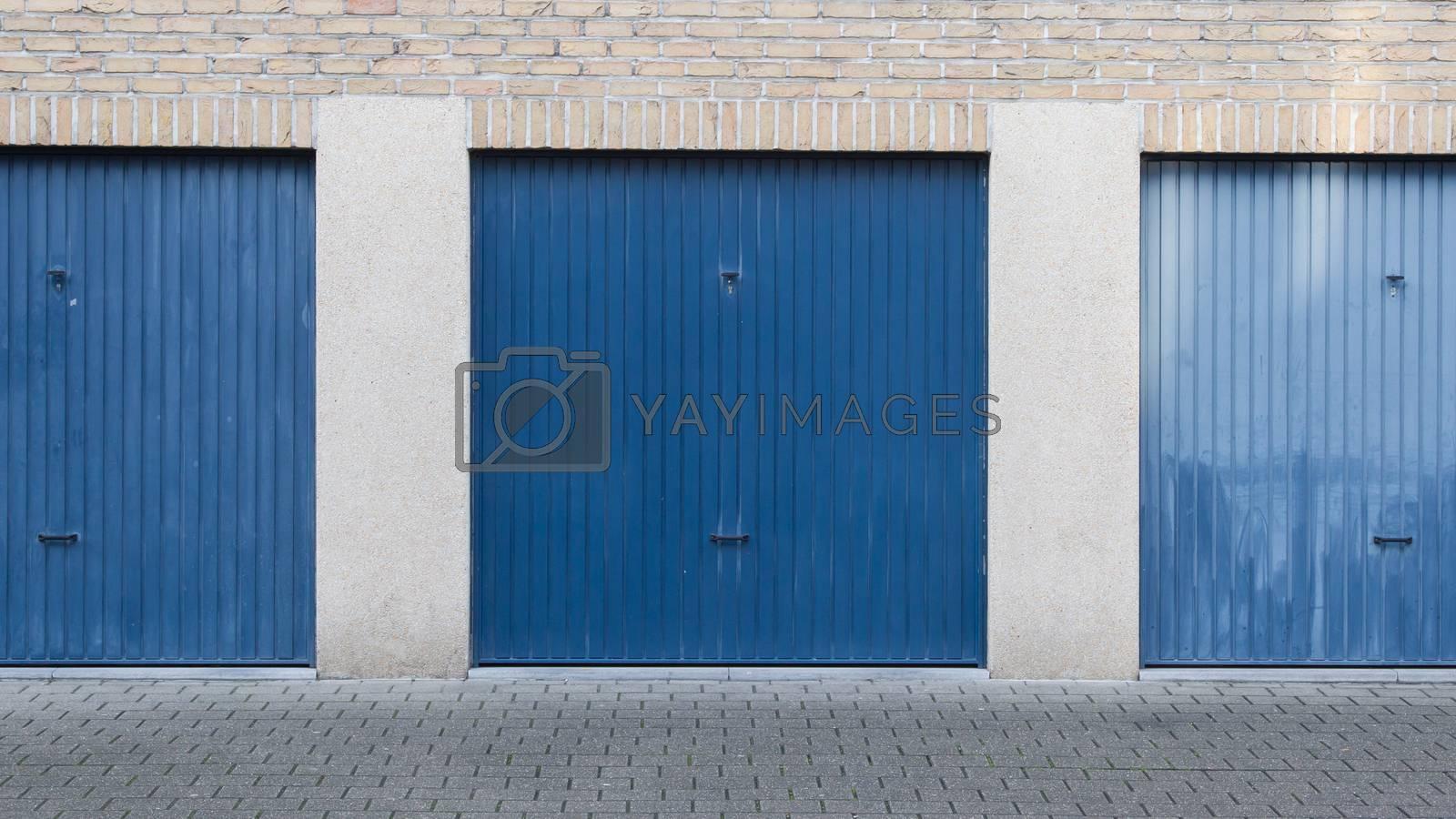 Old blue door of a garage by michaklootwijk