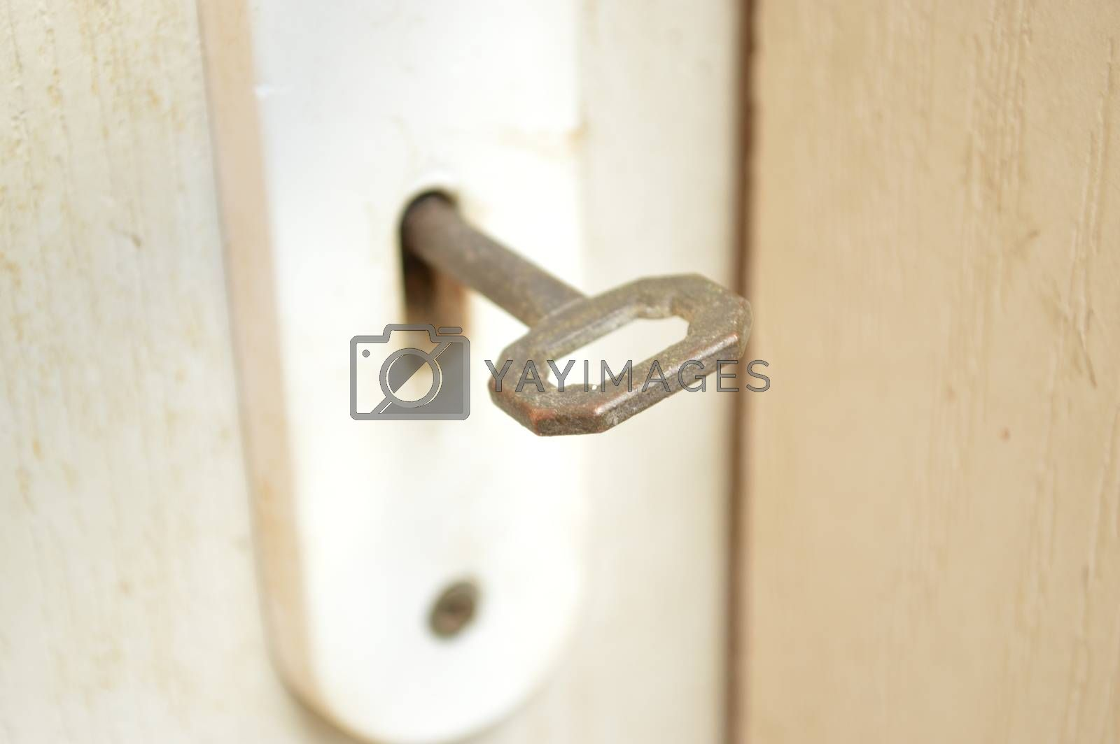 Key in the keyhole - close up photo