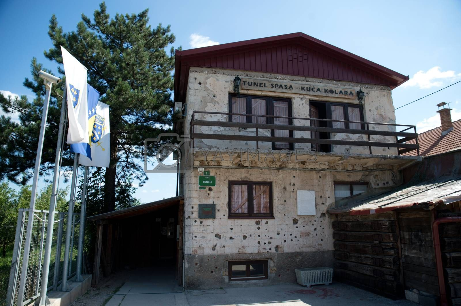 Sarajevo, Bosnia - July 7, 2016:The house through which Sarajevo Tunnel connected the city with other parts during the Siege of Sarajevo constructed in 1993. Note the bullet holes on walls.