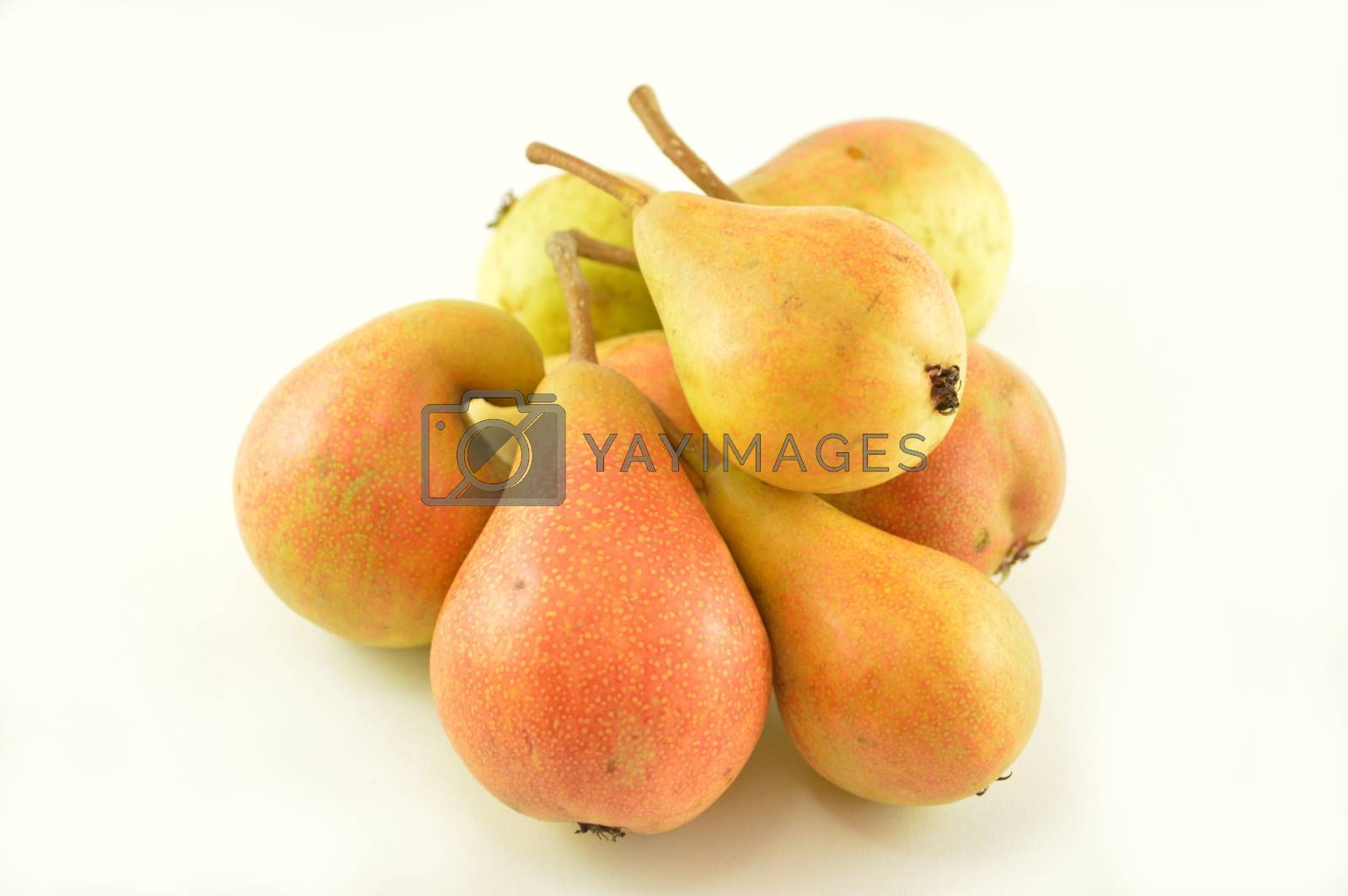 Pears in a bowl isolated on a white background.