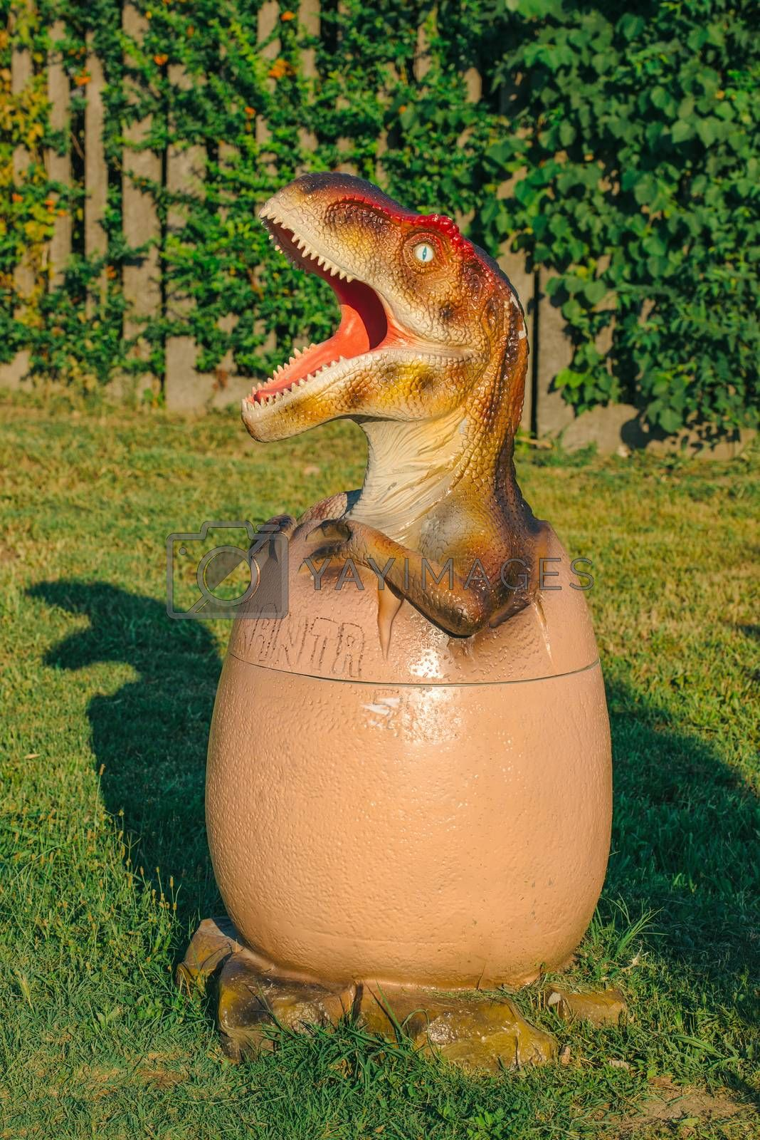 NOVI SAD, SERBIA - AUGUST 5, 2016: Small dinosaur trash bin toy from themed entertainment Dino Park in Novi Sad.