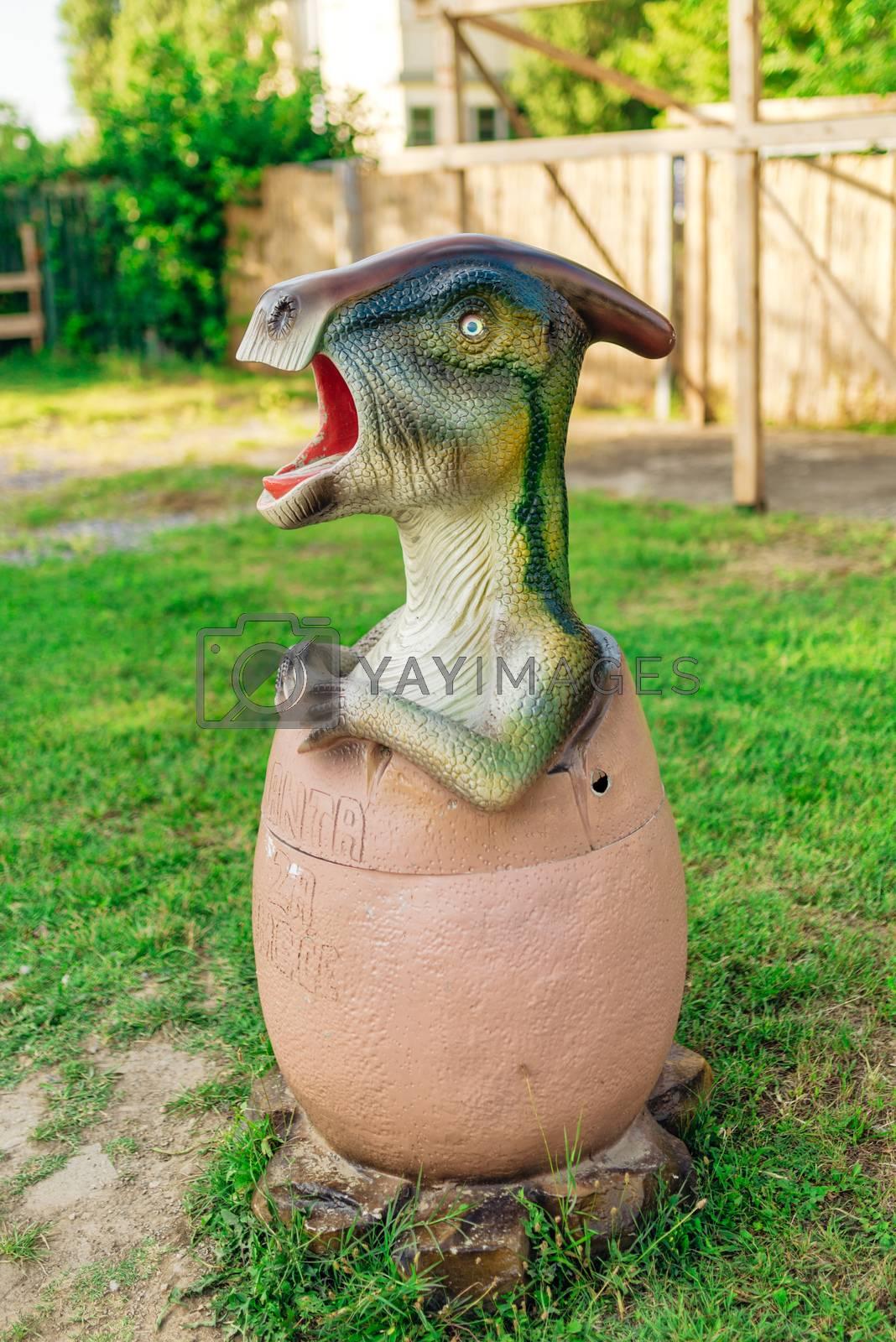 NOVI SAD, SERBIA - AUGUST 7, 2016: Small dinosaur trash bin toy from themed entertainment Dino Park in Novi Sad.