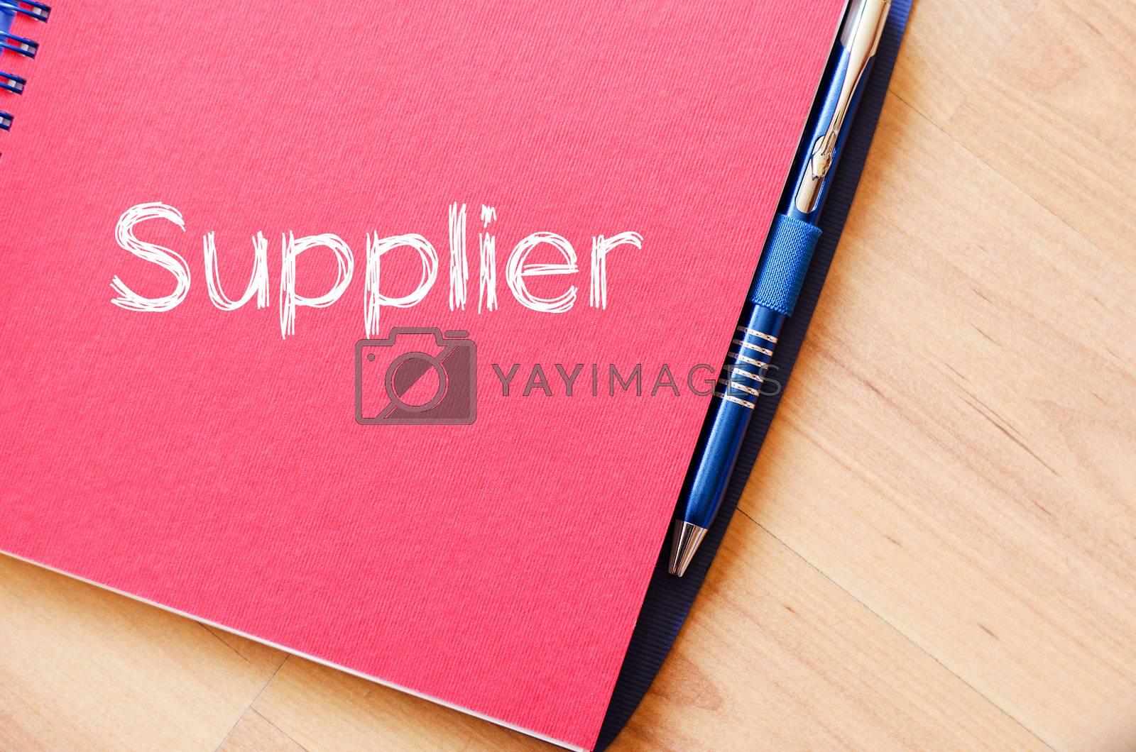 Supplier write on notebook by eenevski