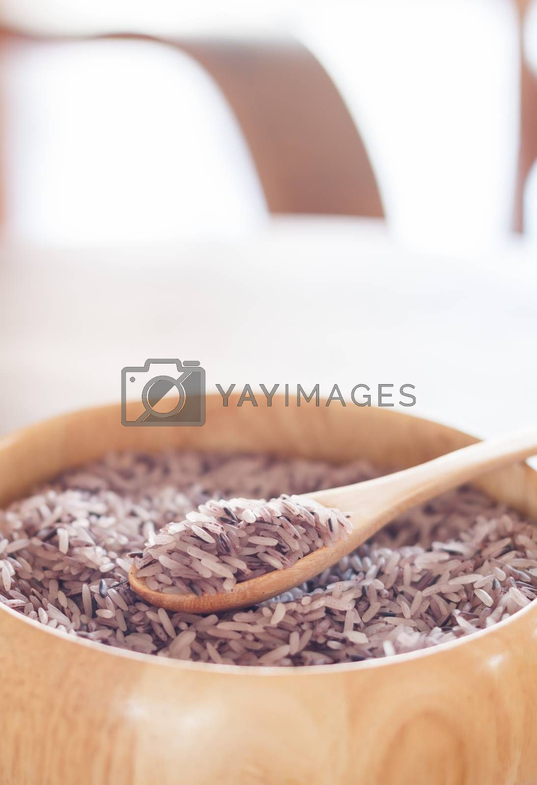 Berry rice in wooden bowl, stock photo