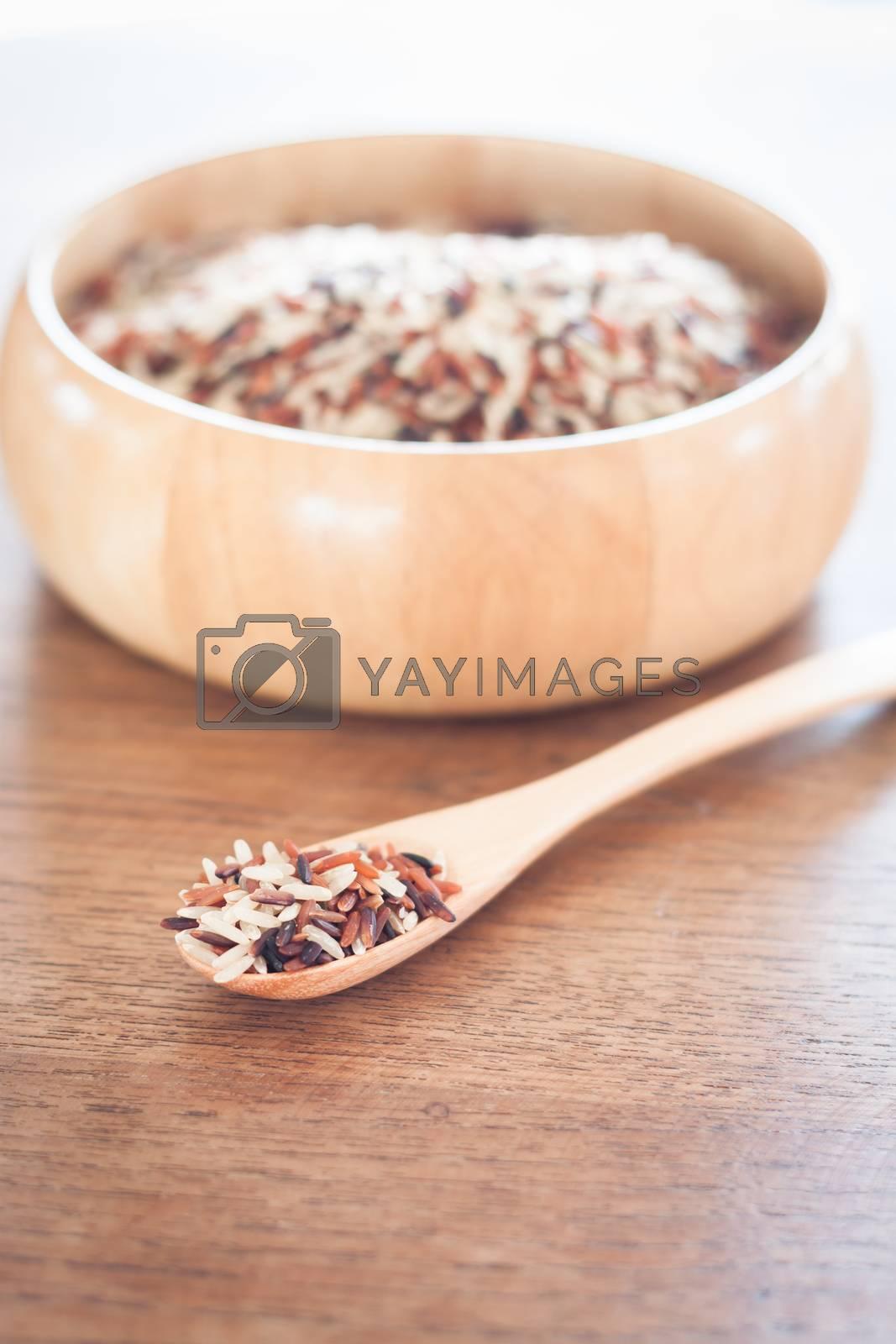 Organic Dry Multi Grain Rice in wooden bowl, stock photo