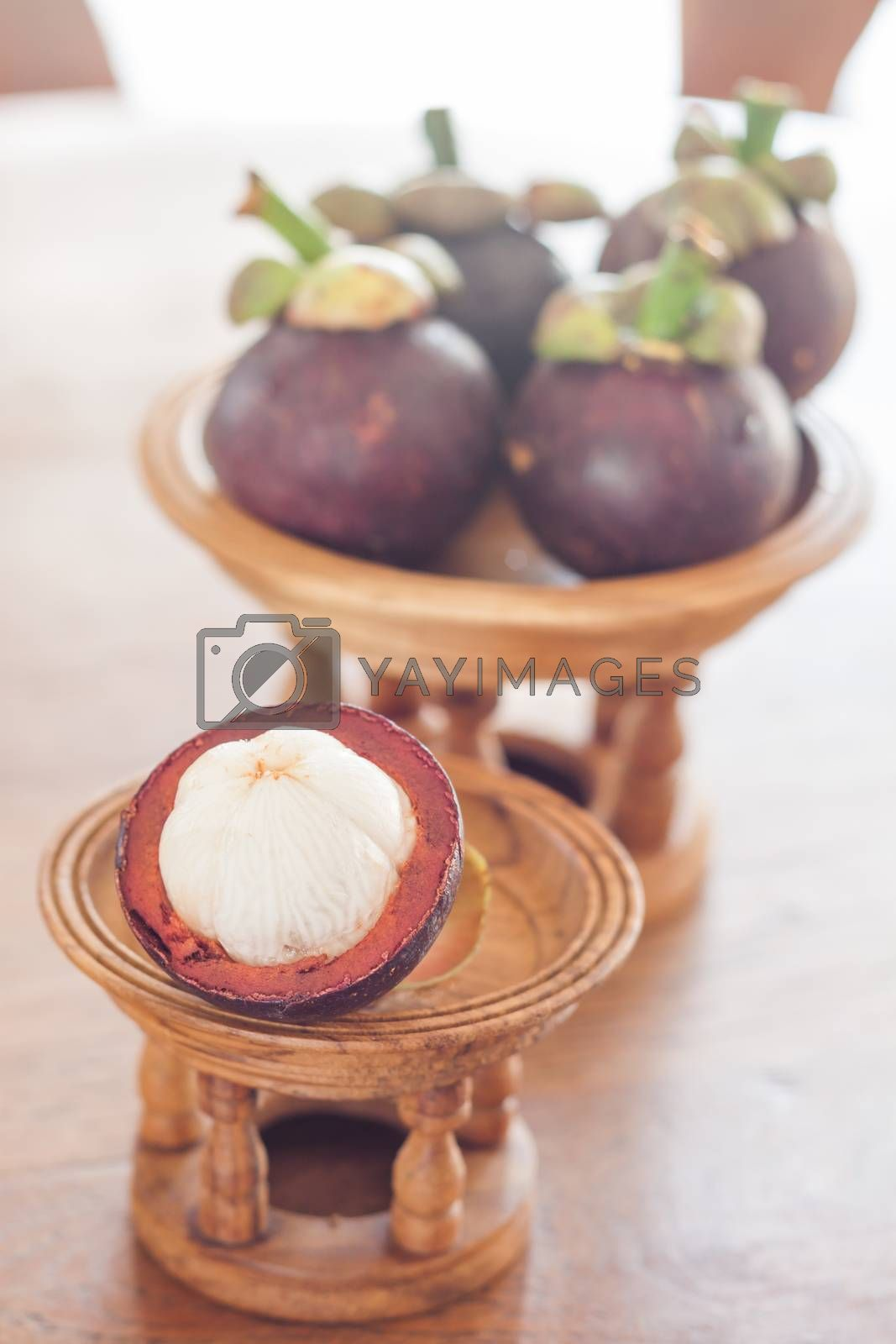 Group of mangoesteen on wooden tray, stock photo