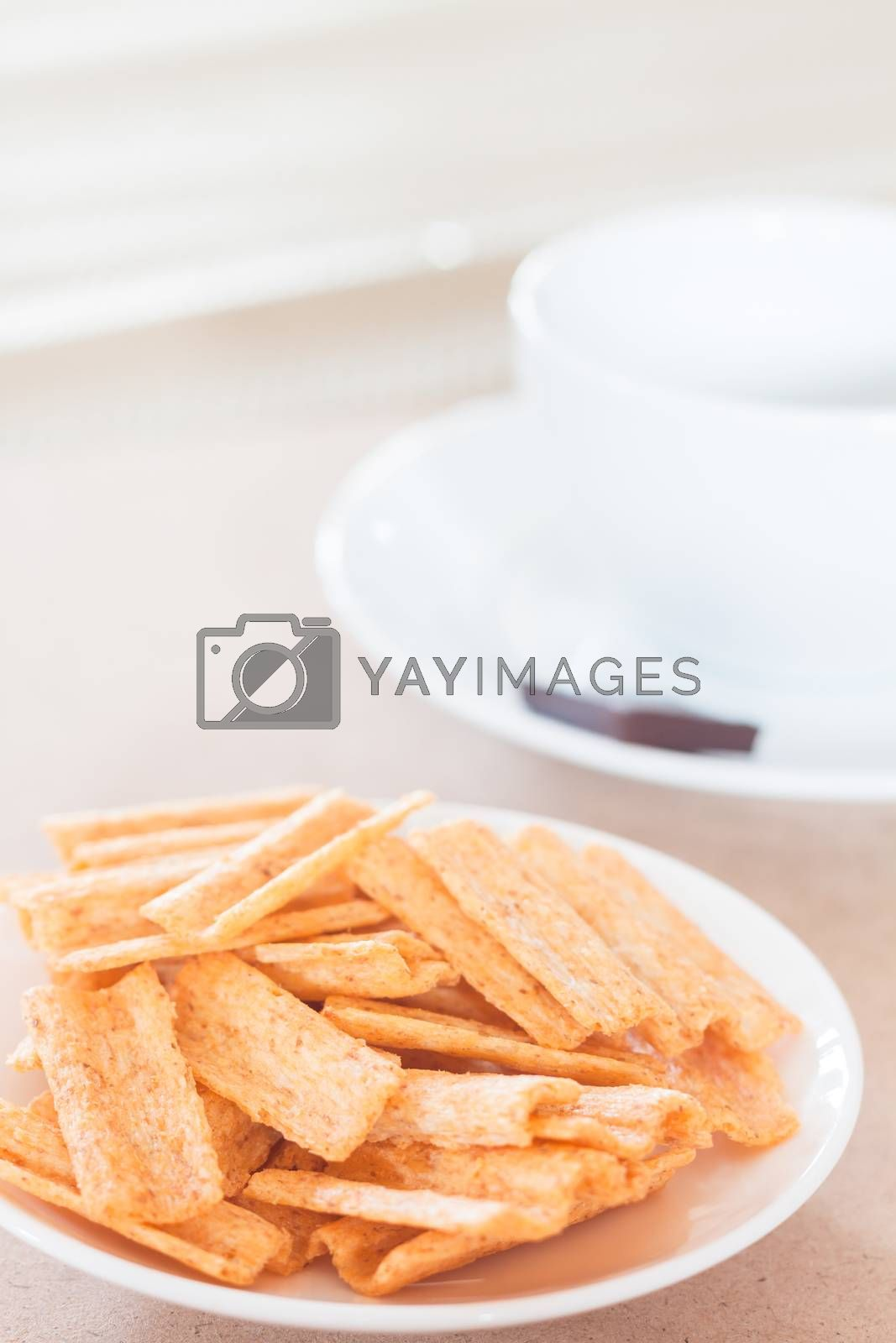 Snack on white plate with coffee cup, stock photo