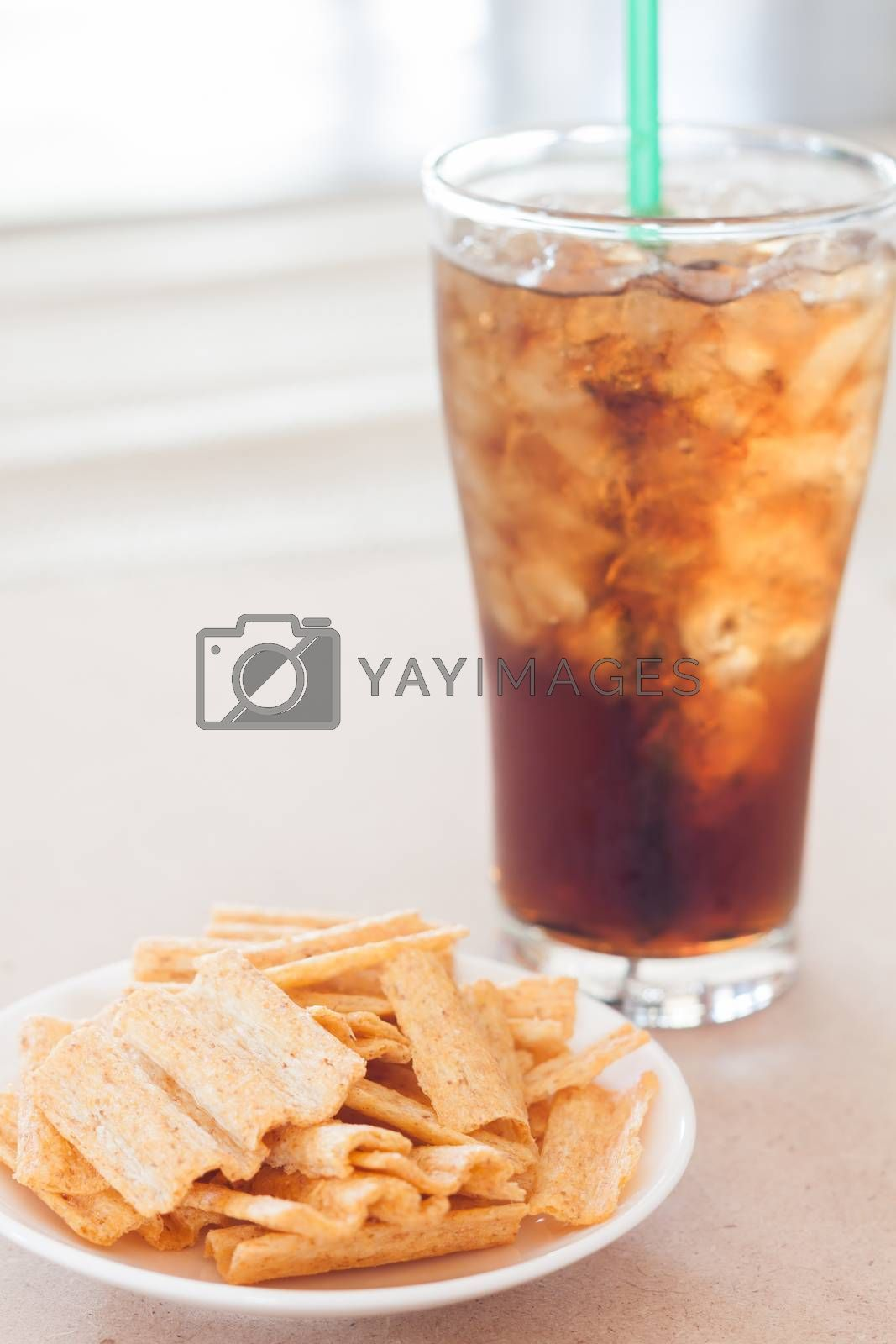 Snack on white plate with a glass of cola , stock photo