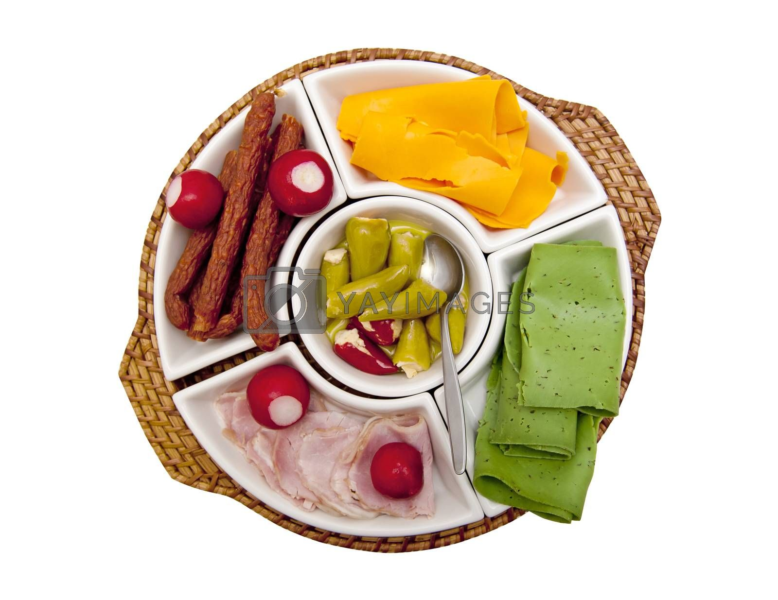 Plate with snacks isolated on the white background