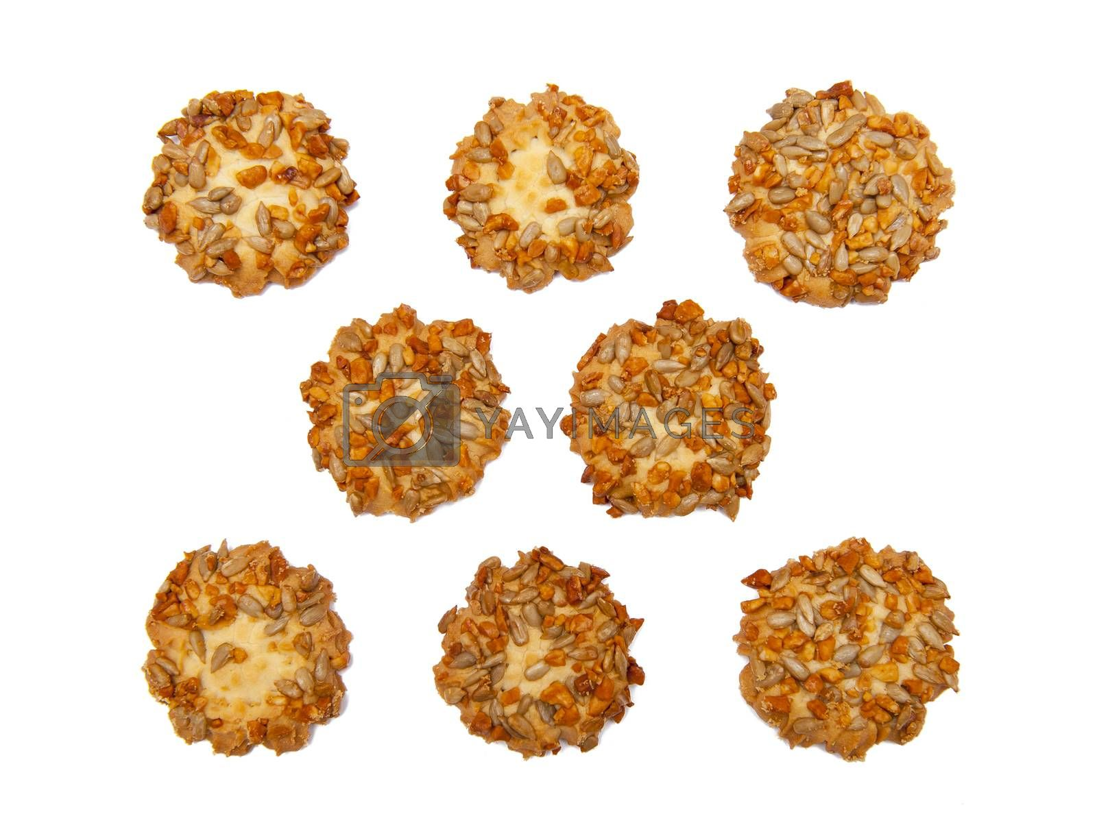 Cookies with nuts and sunflower seeds isolated on the white background