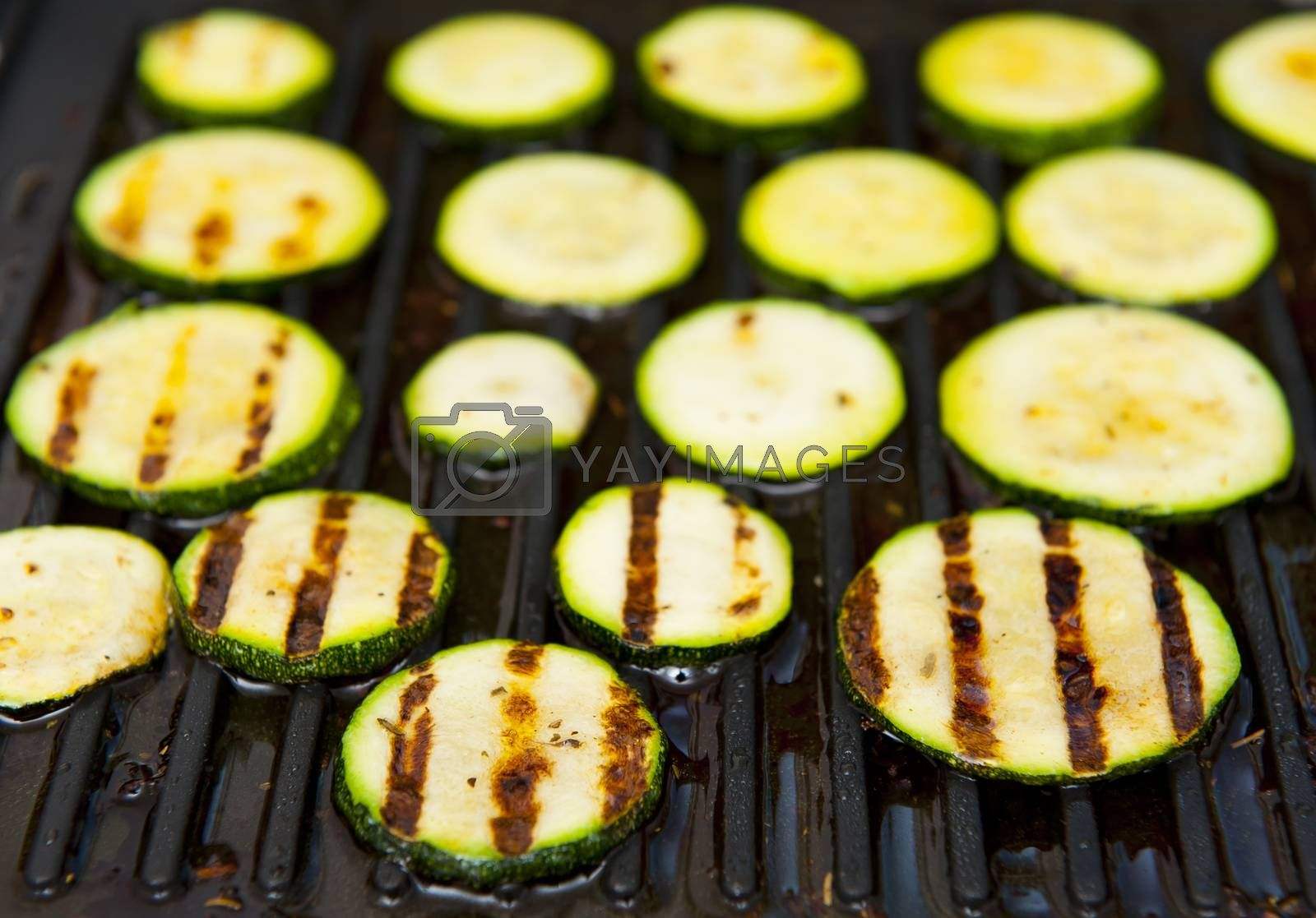 Courgette isolated on the grill background