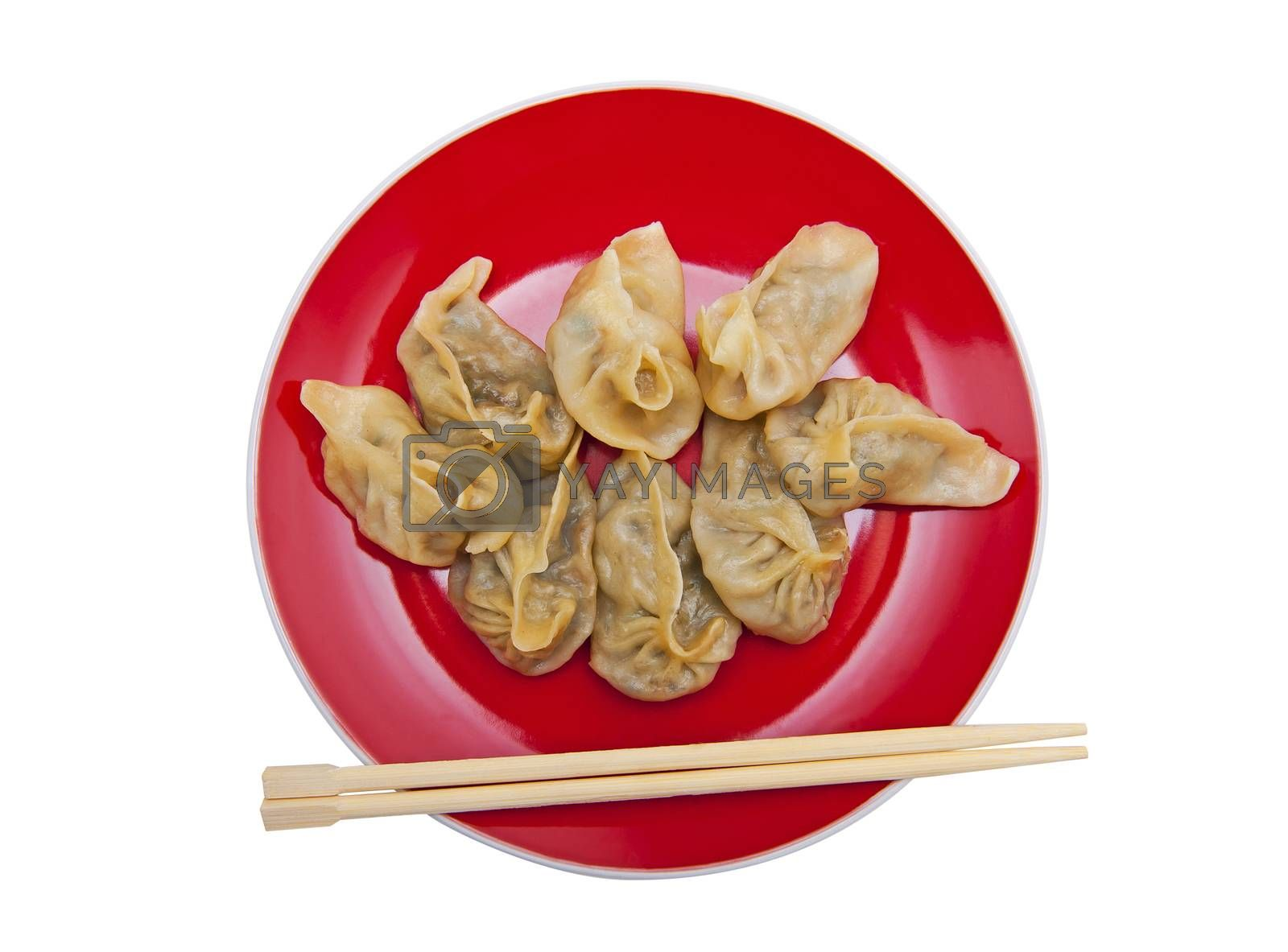 Dumplings on the red plate isolated on the white background