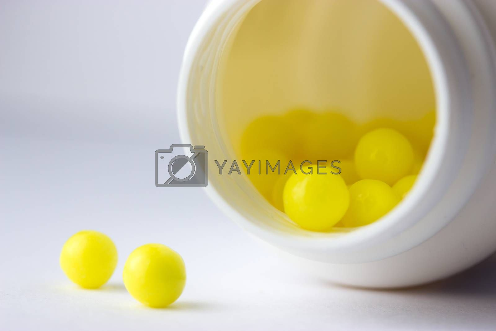 open bottle with yellow pills (not isolated)