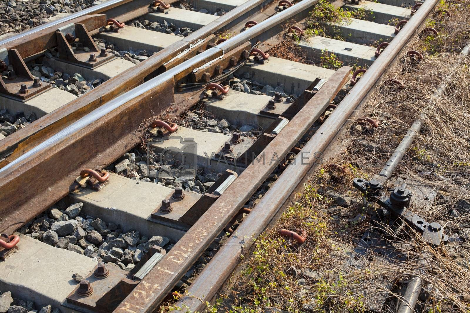 Angle shot of a rusty but still usable railway