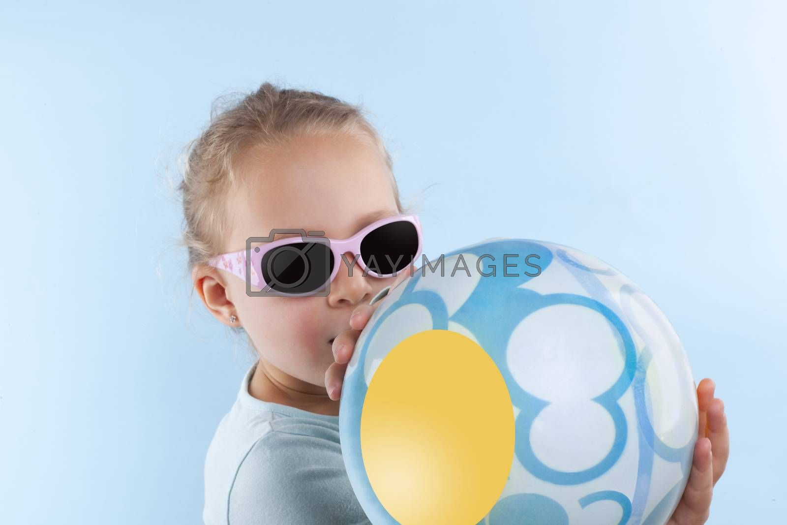 Summer. Beautiful small girl with ball and sunglasses. by eskymaks