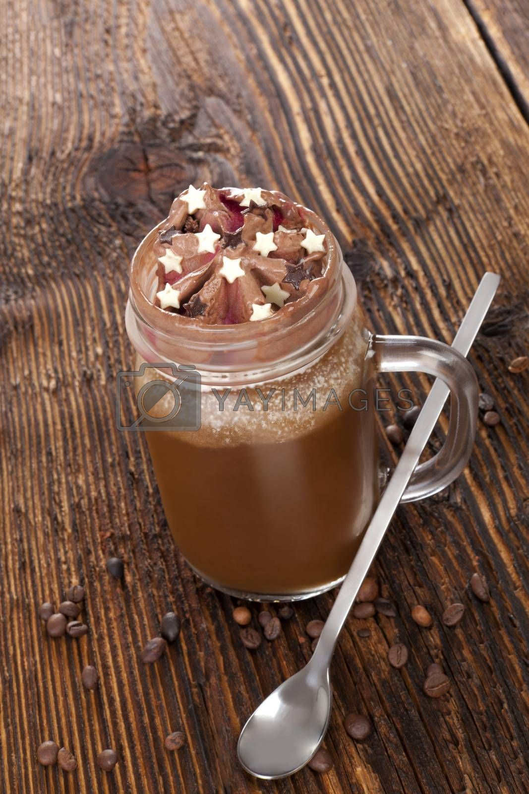 Hot chocolate on wooden table. Delicious cocoa drink.