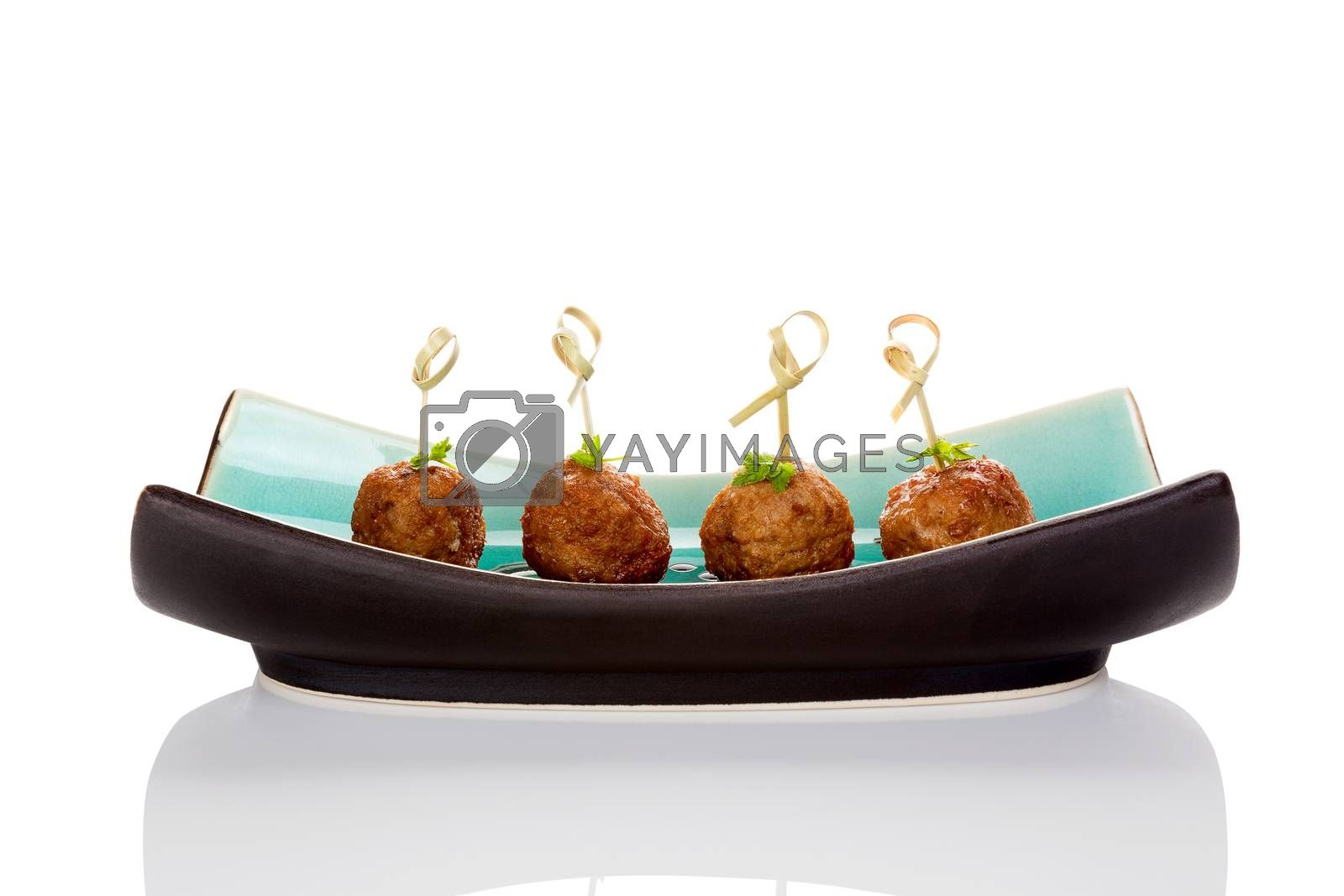 Meatballs canape on ceramic tray isolated on white background. Culinary bbq eating.