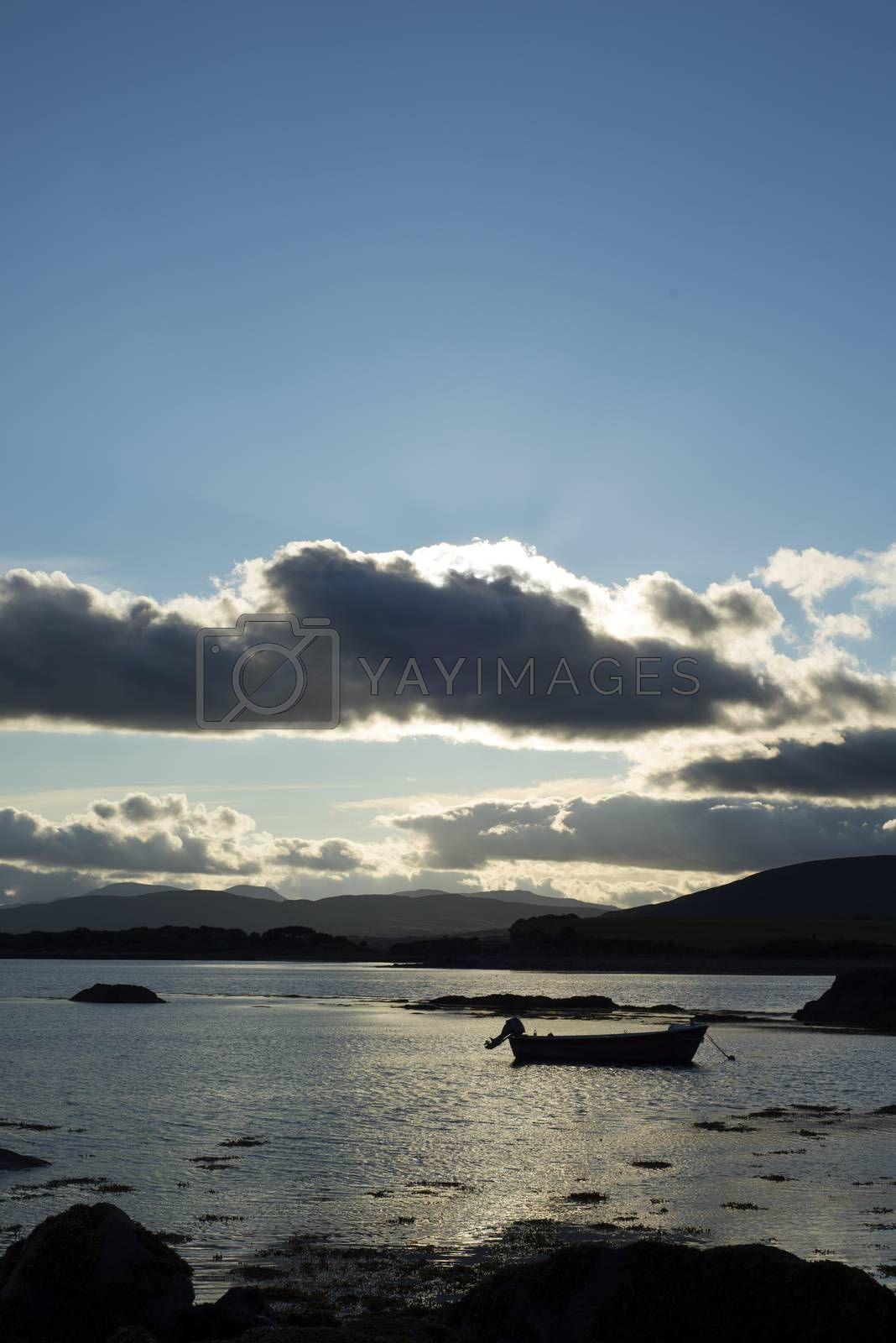 boat in a quiet bay near kenmare on the wild atlantic way ireland at sunset