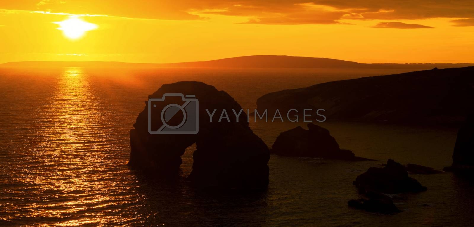 Royalty free image of panoramic sunset over the virgin rock by morrbyte