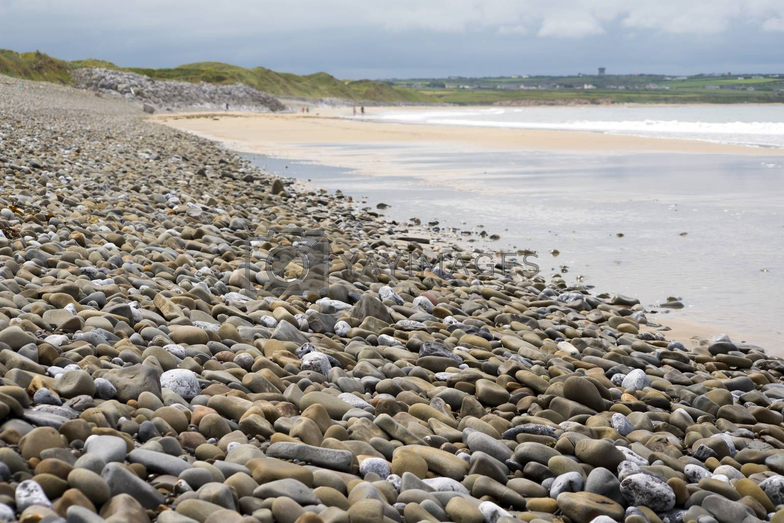 pebbled ballybunion beach beside the links by morrbyte