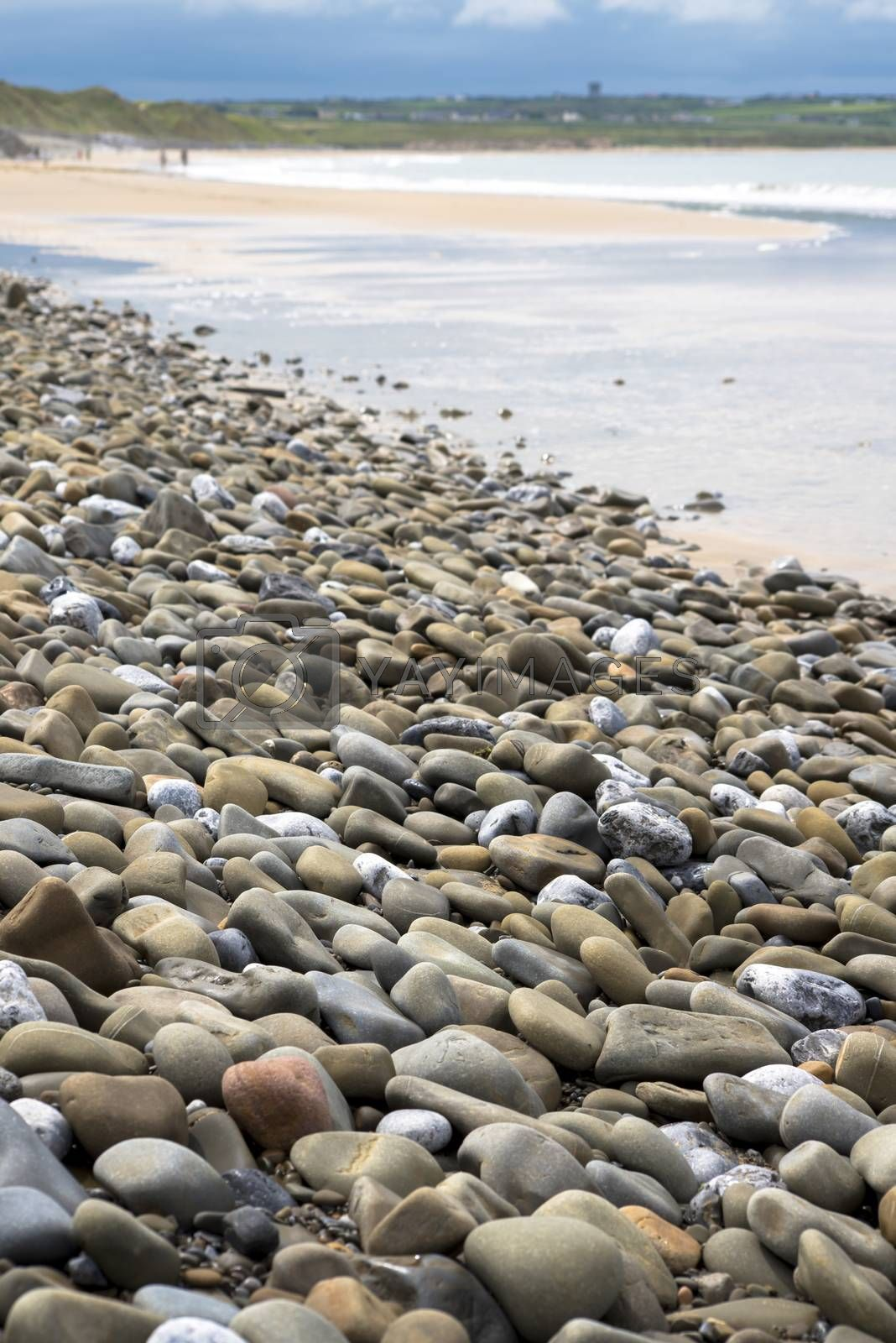 pebbled beach beside the links by morrbyte