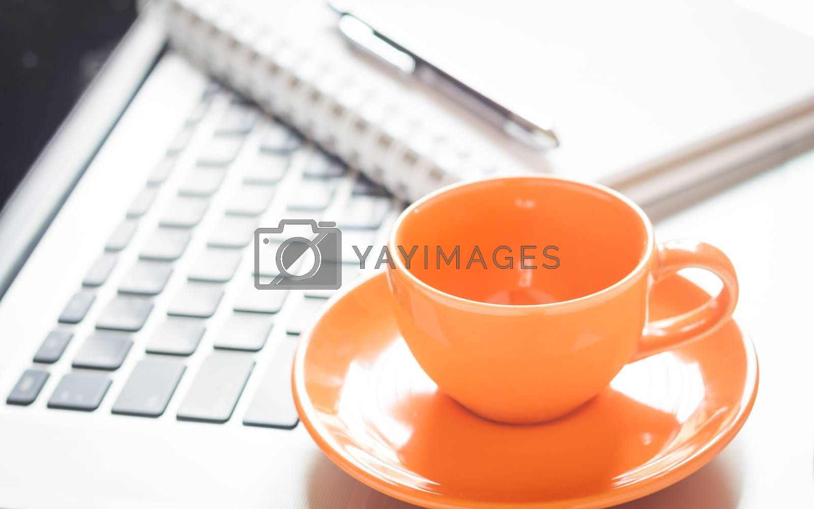 Royalty free image of Laptop with coffee cup and notepad on desk by punsayaporn