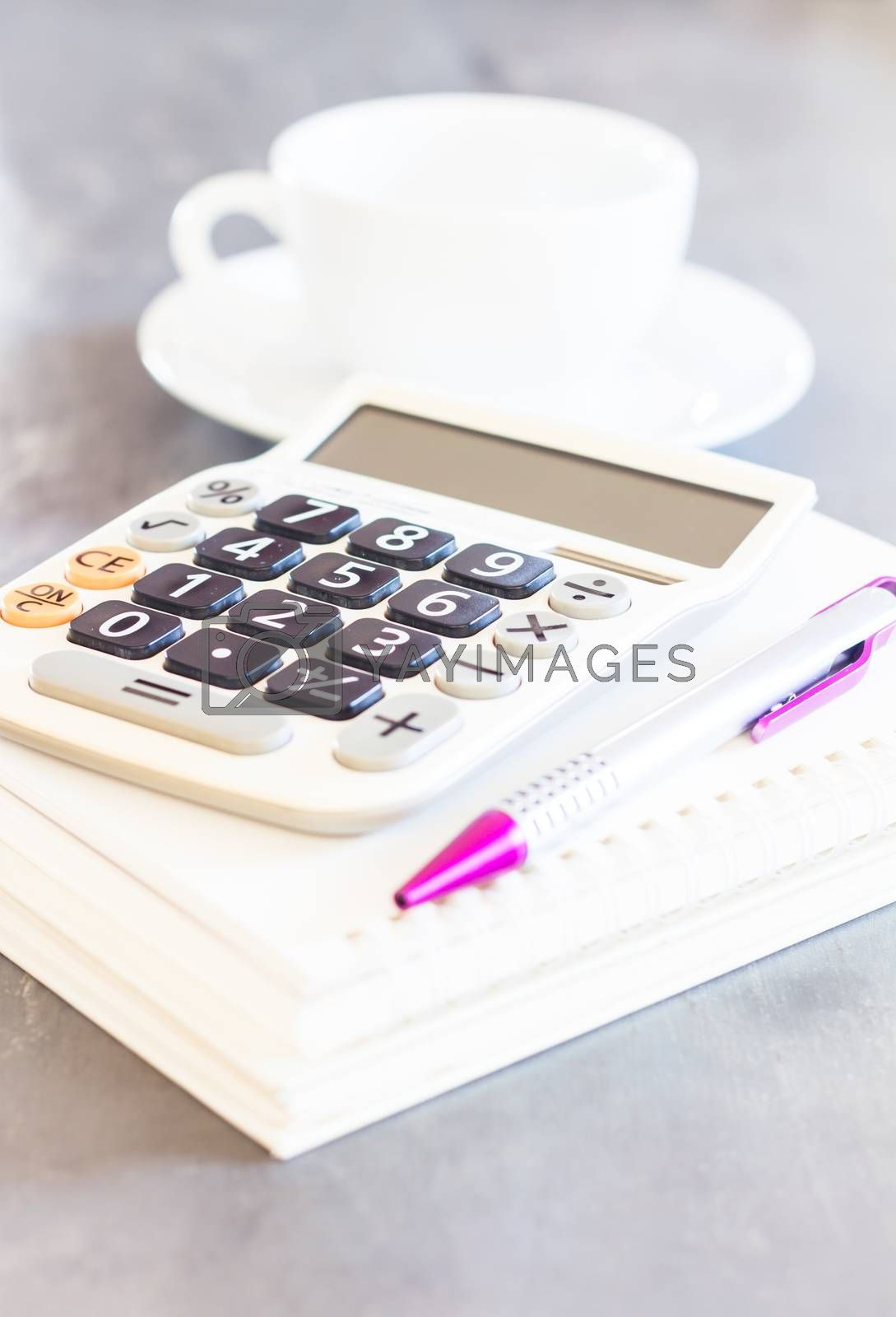 Royalty free image of Calculator, pen and notepad for notes by punsayaporn