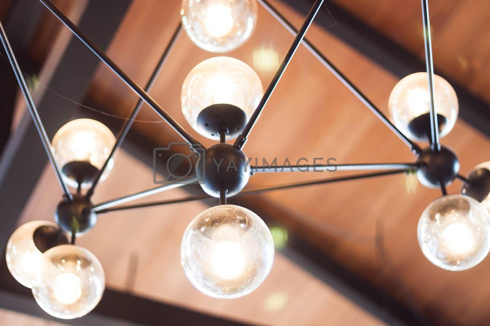 Royalty free image of Beautiful light lamp decorated in coffee shop by punsayaporn