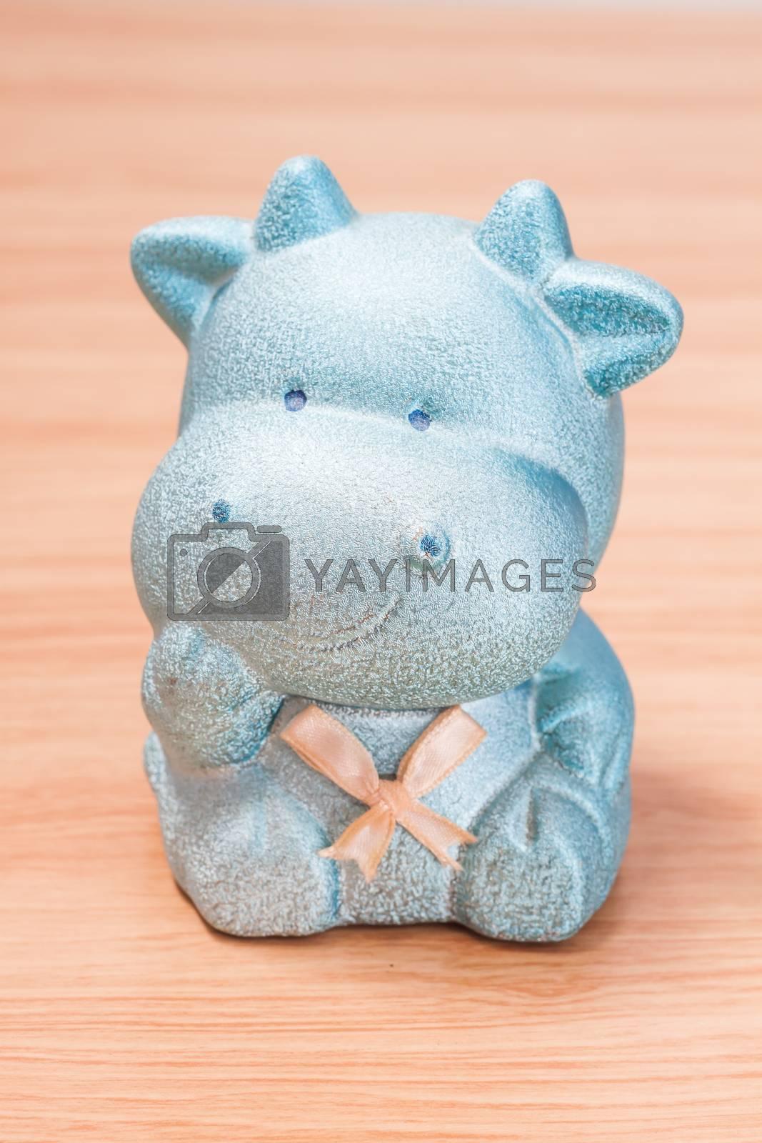 Royalty free image of Green cow doll saving box by punsayaporn