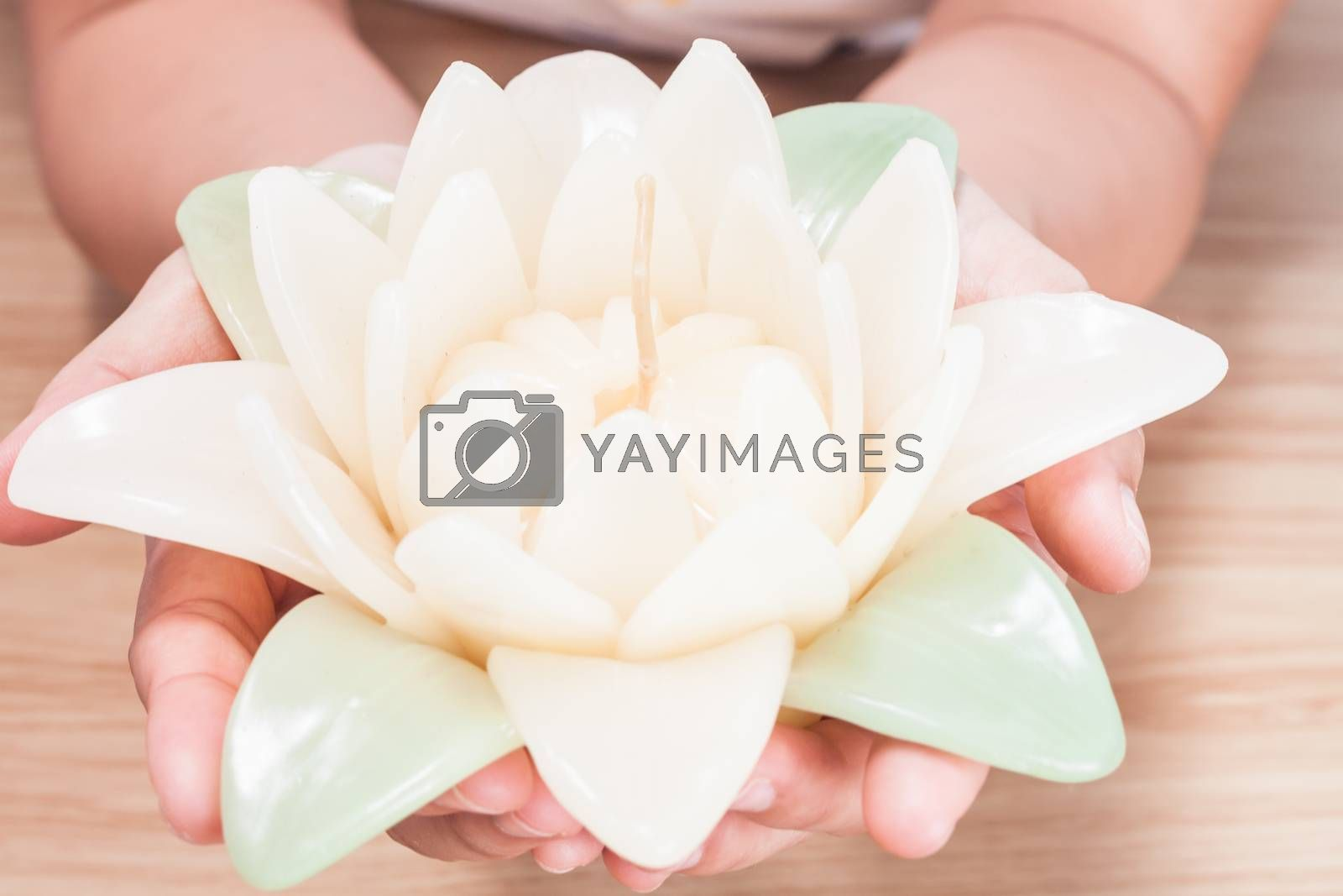 Royalty free image of Close up of flower candle by punsayaporn