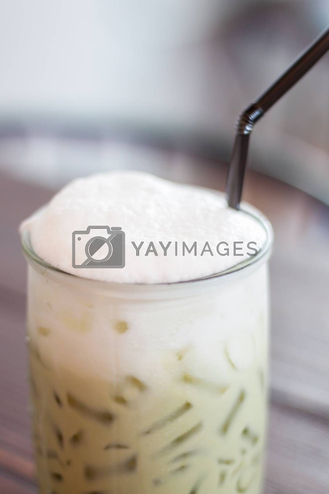 Royalty free image of Iced green tea with microfoam by punsayaporn