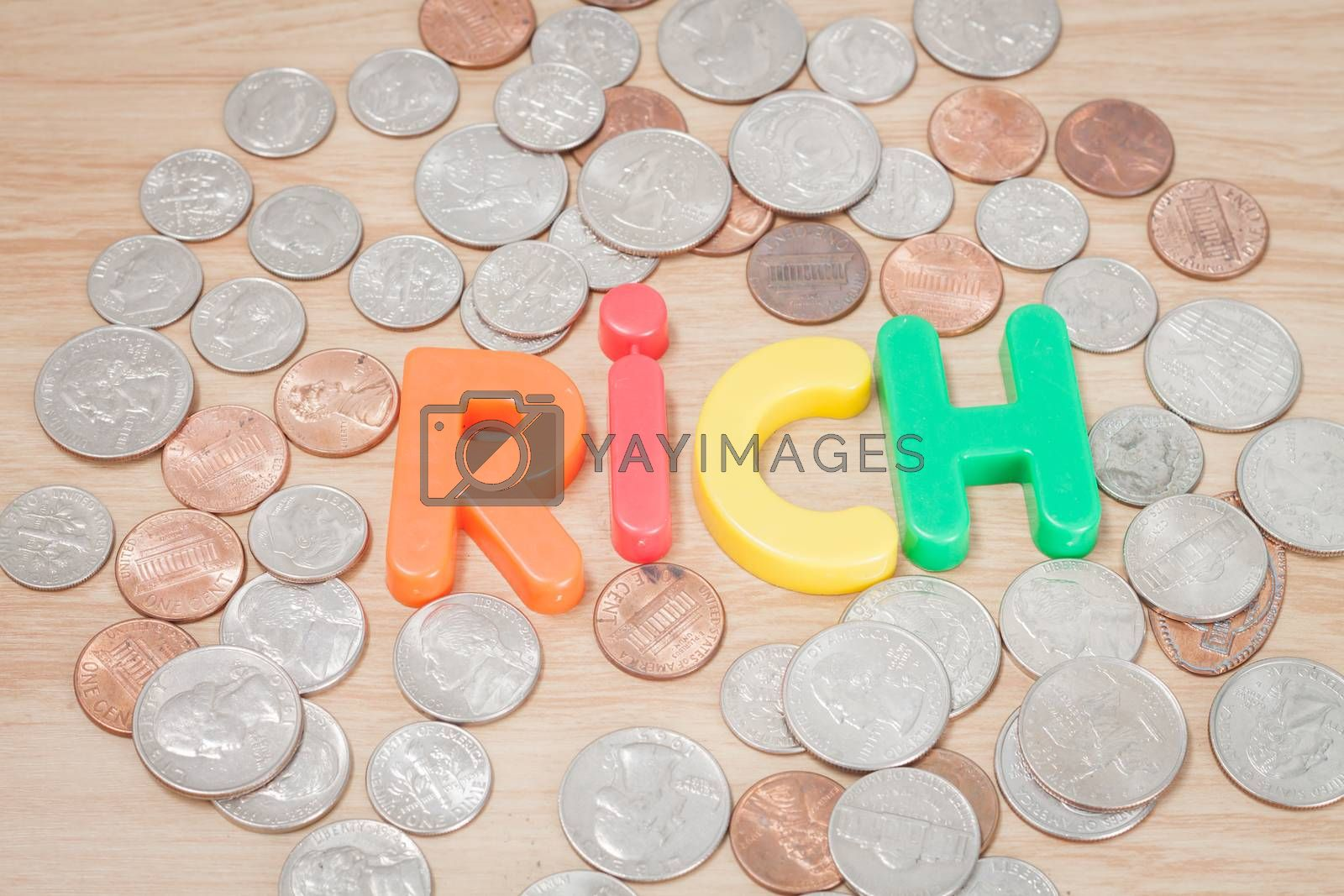 Royalty free image of Rich alphabet with various US coins by punsayaporn