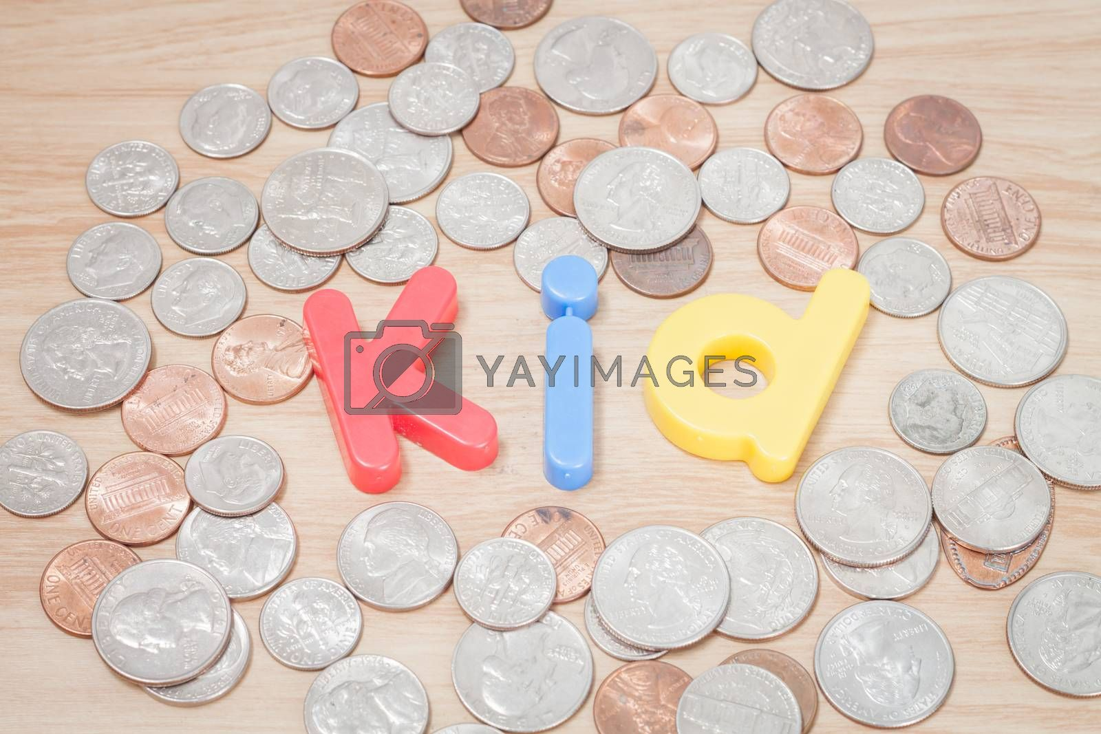 Royalty free image of Kid alphabet with various US coins by punsayaporn