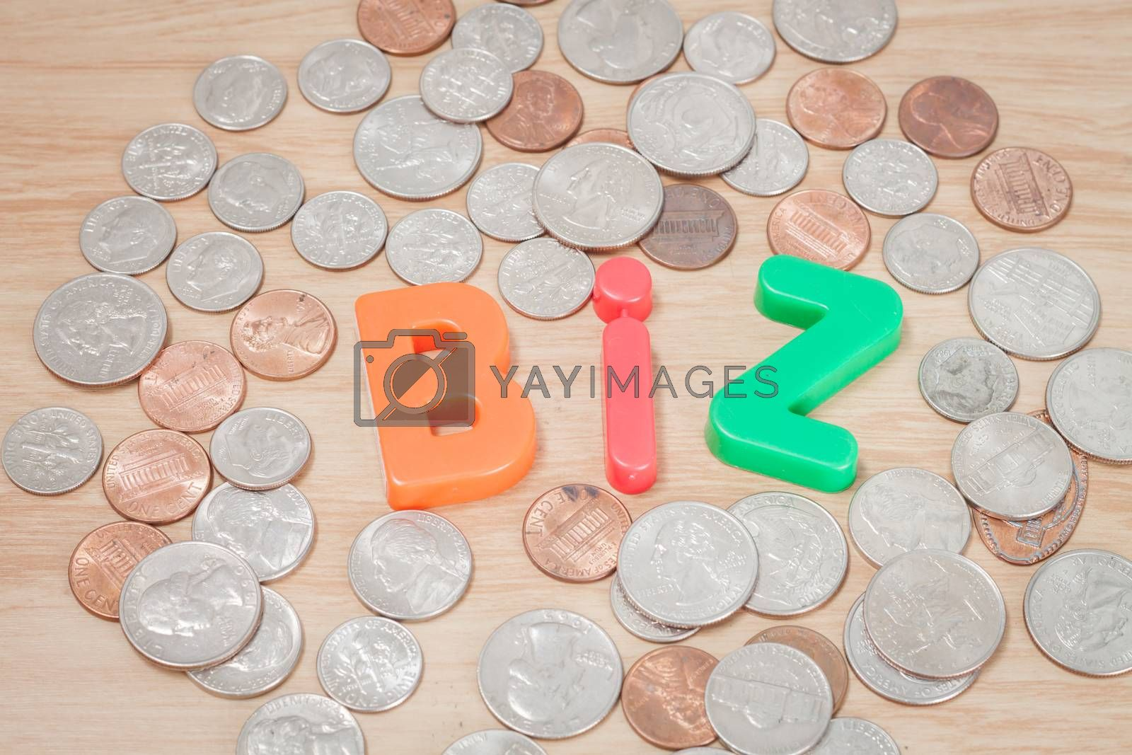 Royalty free image of Biz alphabet with various US coins by punsayaporn