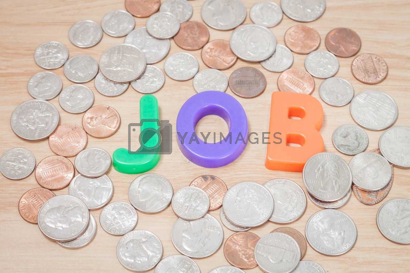 Royalty free image of Job alphabet with various US coins by punsayaporn