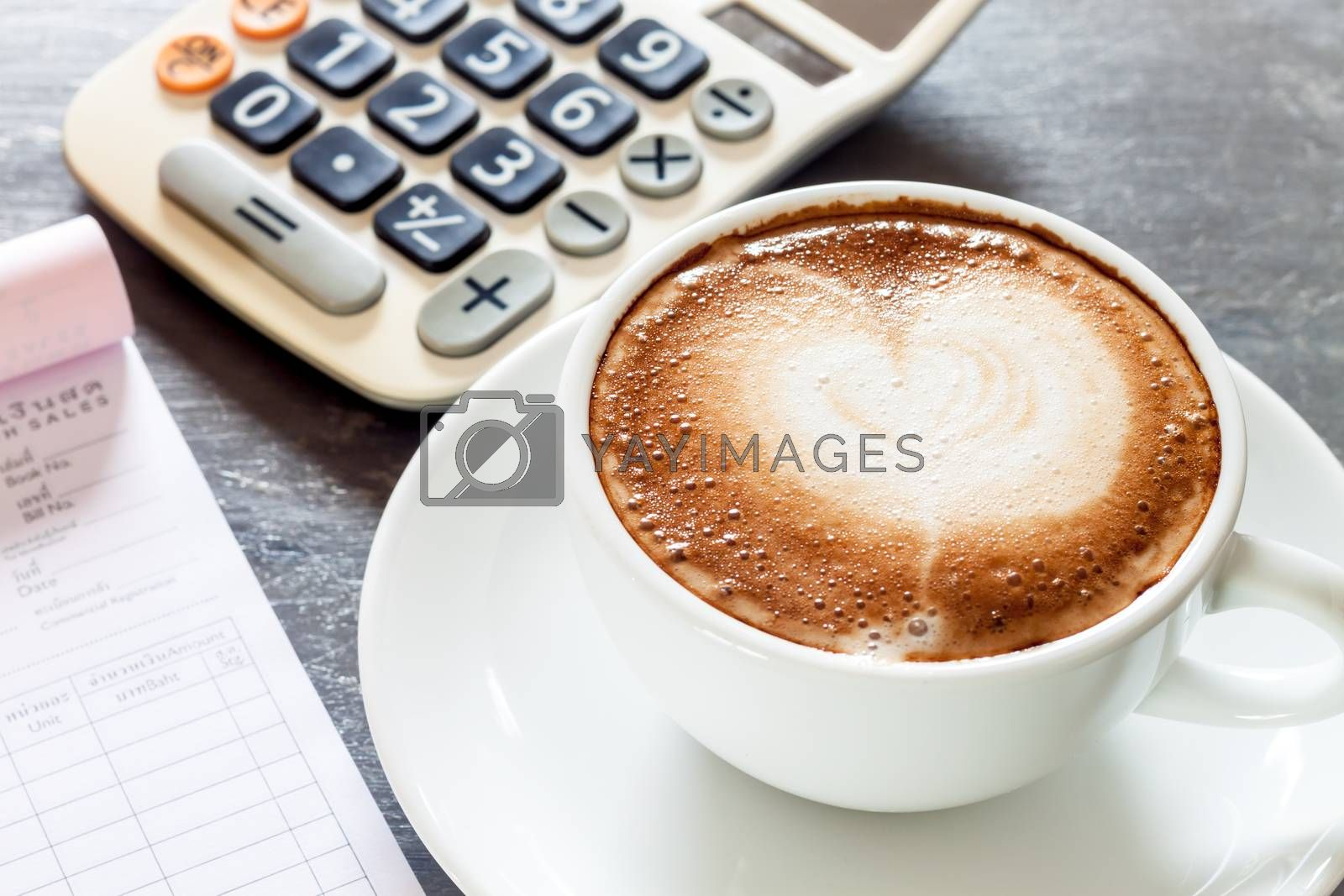 Royalty free image of Coffee cup on work station by punsayaporn