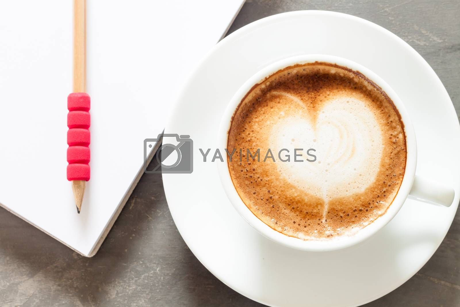 Royalty free image of Coffee cup with notepad on grey background by punsayaporn