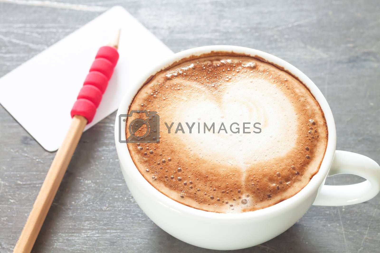 Royalty free image of Coffee cup with name card on grey background by punsayaporn