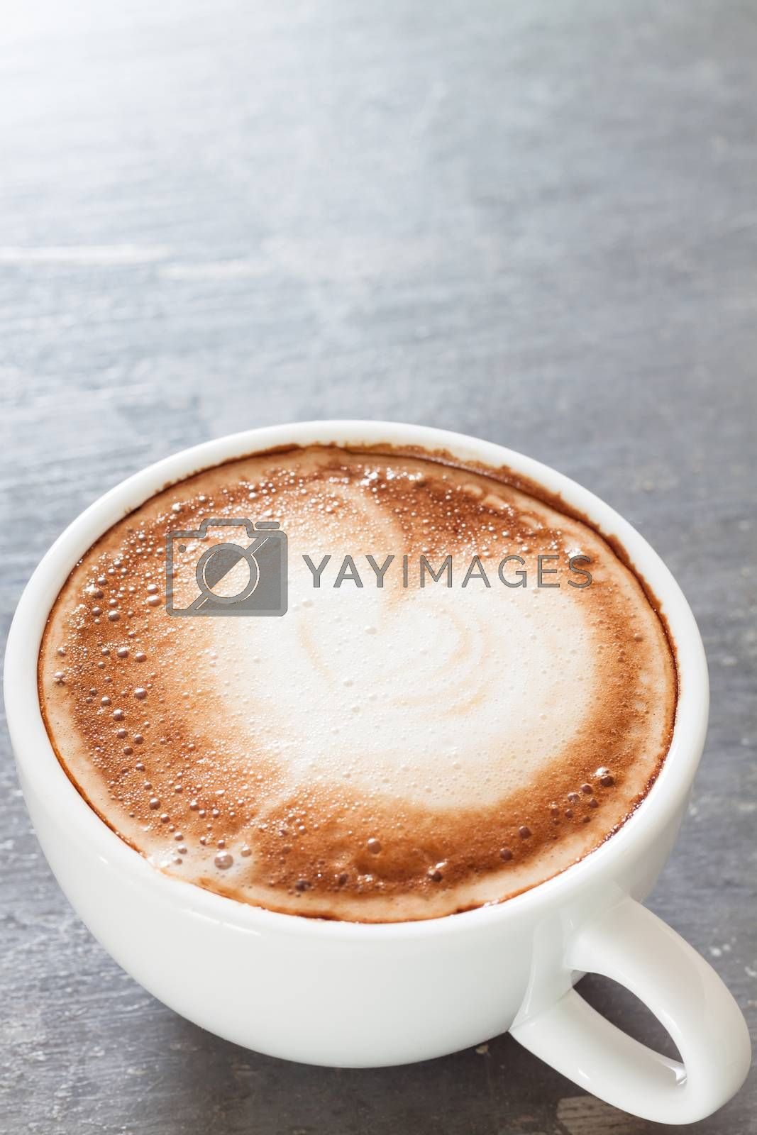 Royalty free image of Coffee cup on grey background by punsayaporn