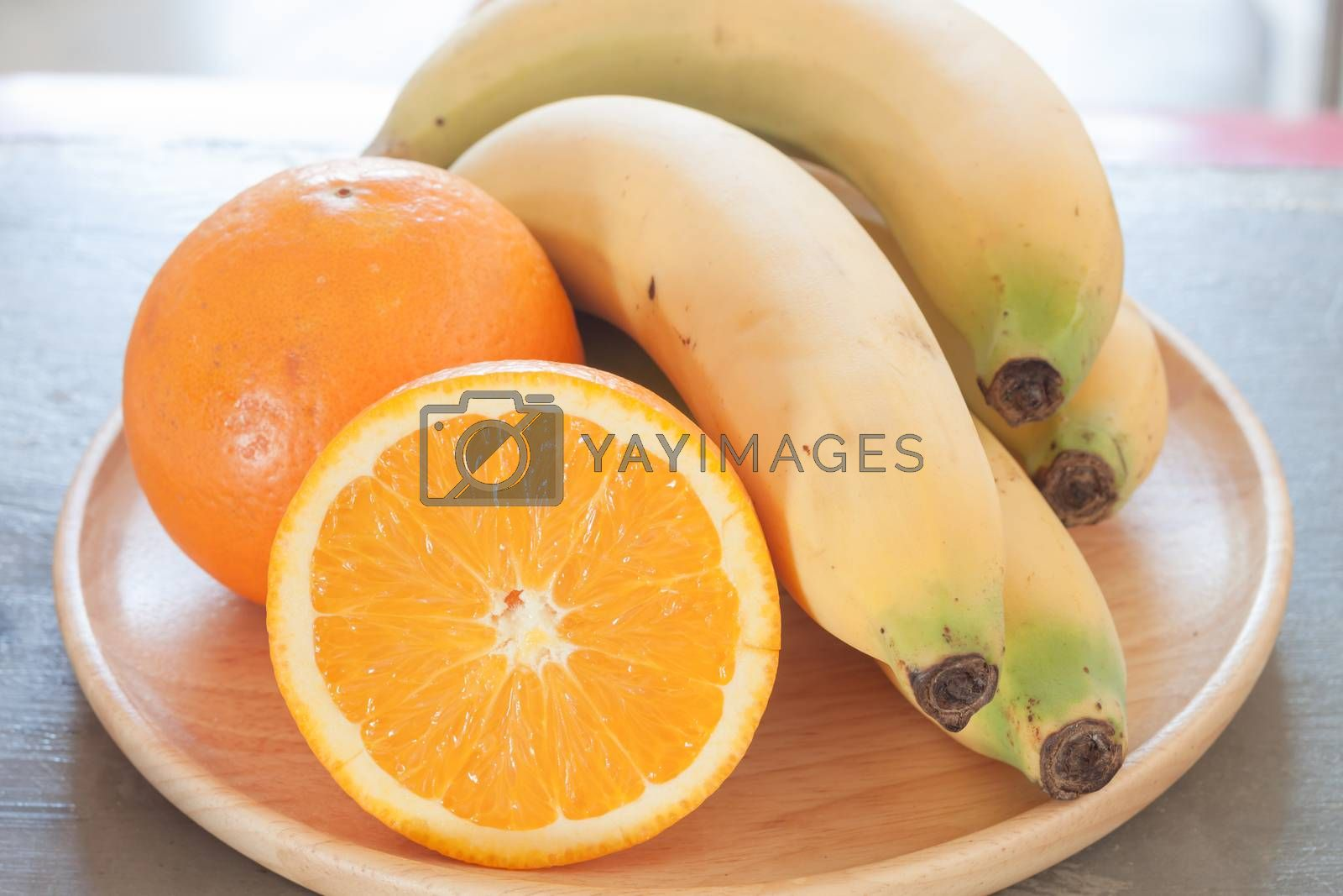 Royalty free image of Healthy fruits with oranges and bananas by punsayaporn