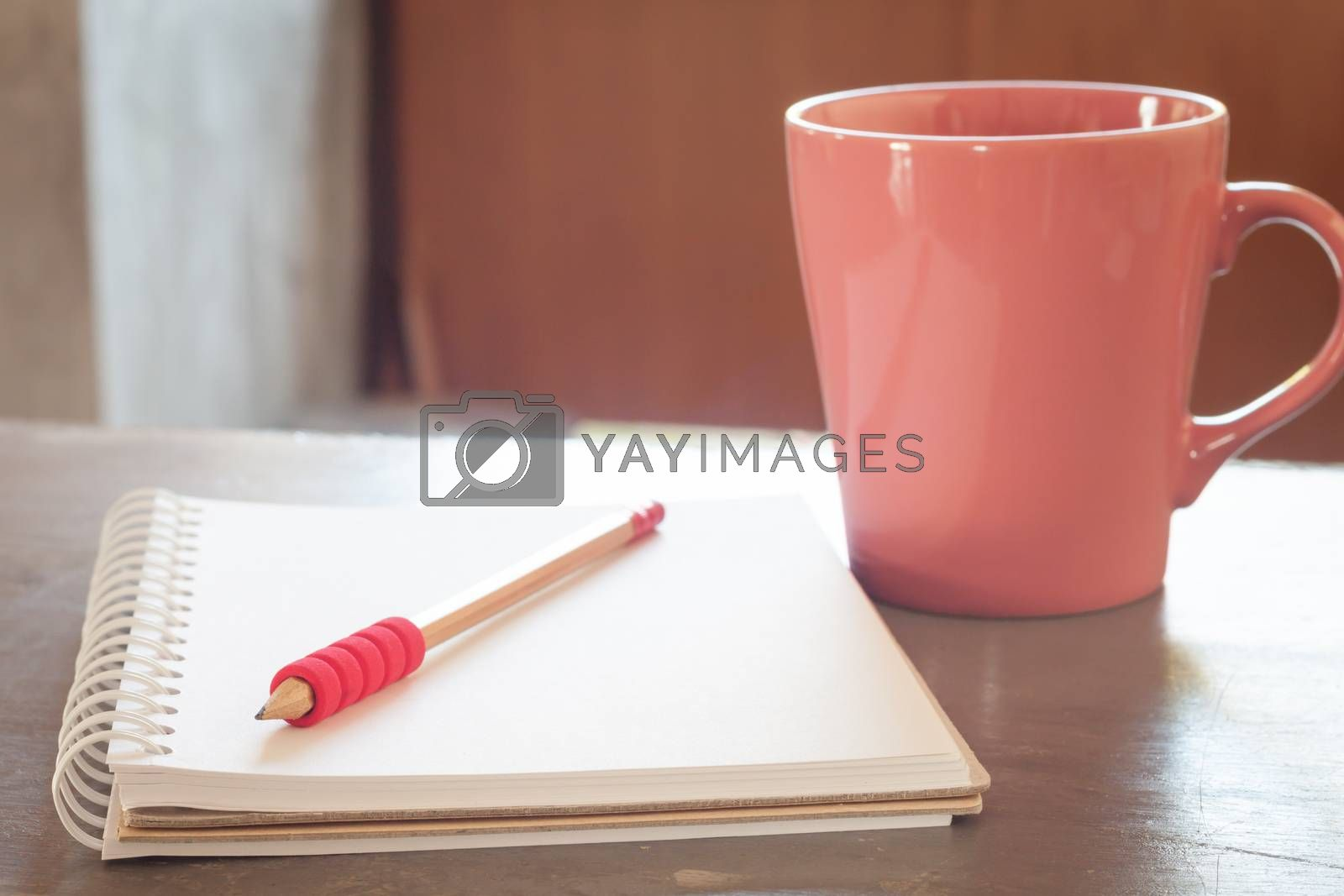Royalty free image of Blank notebook with pencil on grey background by punsayaporn
