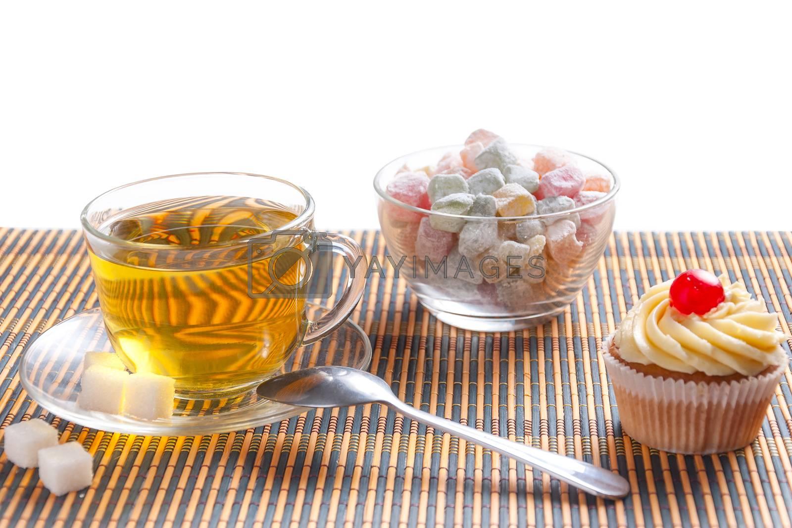 Green tea, fresh cherry muffin, colorful delight and sugar