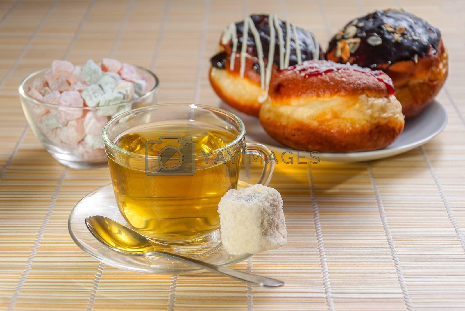 Green tea, fresh cherry muffin, colorful delight and doughnut, sweet dessert