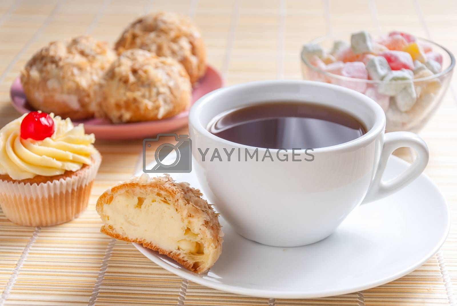 Close up green tea, fresh cherry muffin, colorful delight and eclairs, sweet dessert