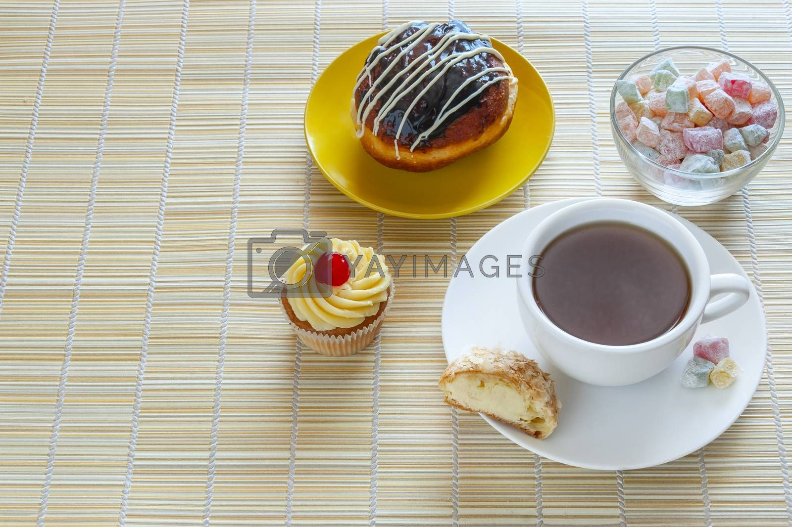 Tea, fresh cherry muffin, colorful delight, half eclair and doughnut, sweet dessert, with place for your text