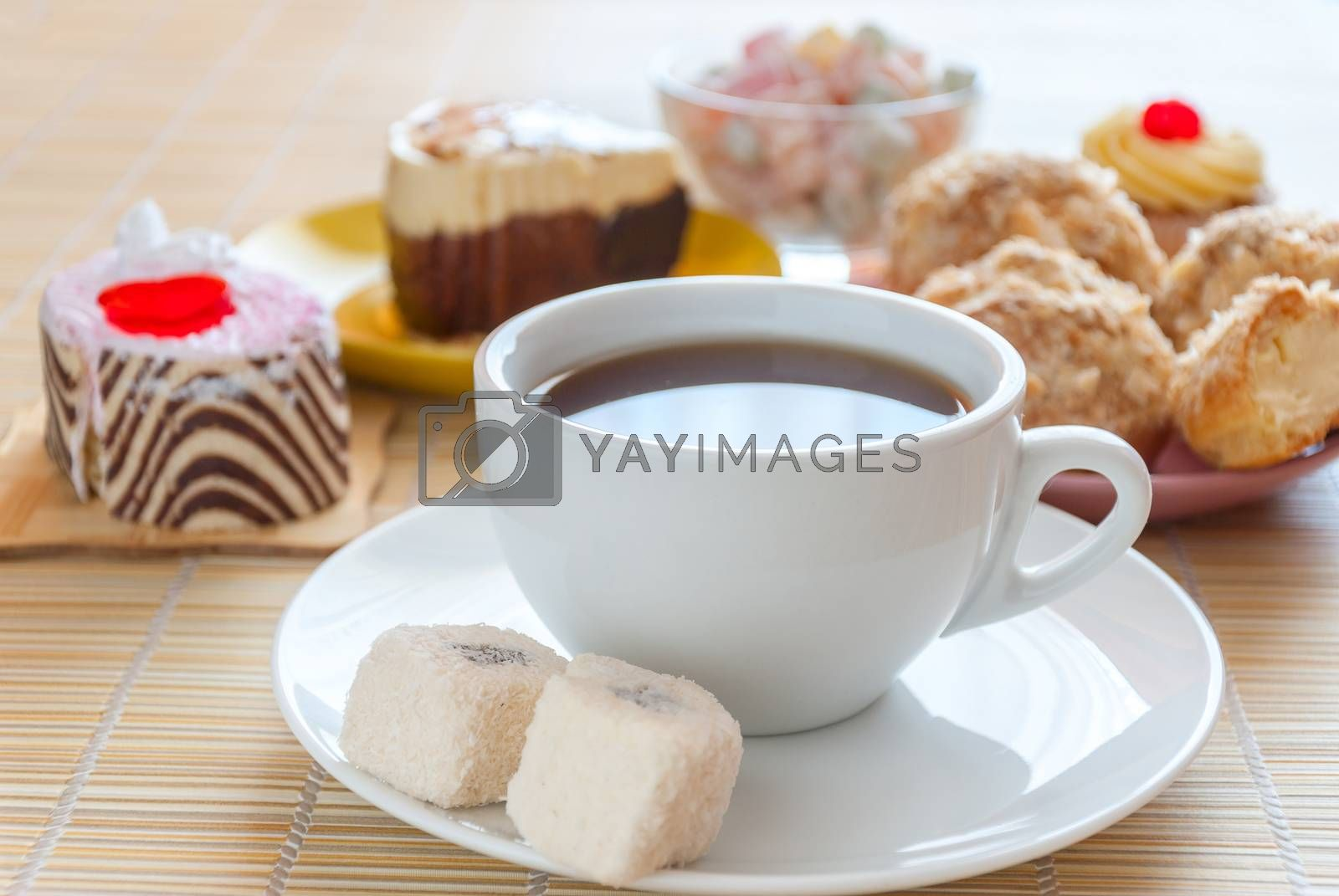 Tea, fresh cherry muffin, colorful delight, eclair and doughnut, various sweet dessert, close up