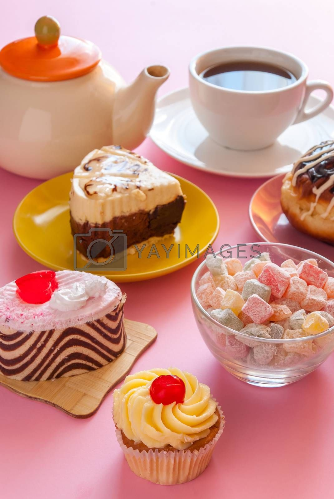 Various tasty sweet dessert with cup of tea