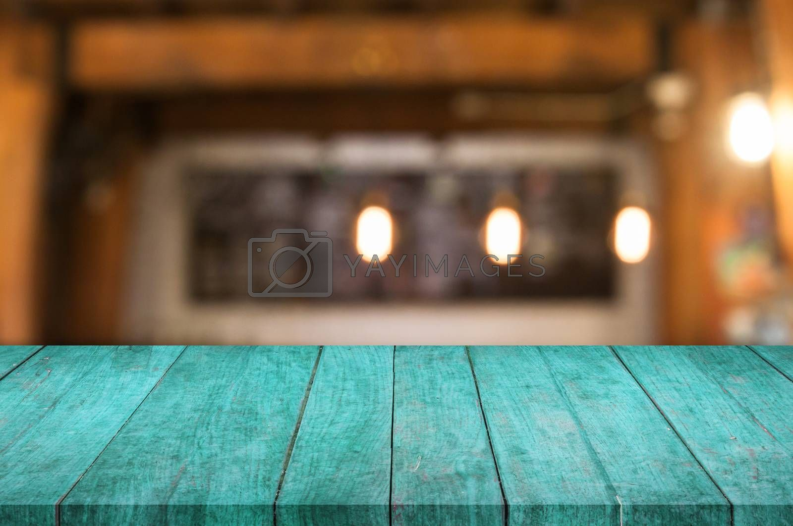 Royalty free image of Blue wooden table top with coffee shop by punsayaporn